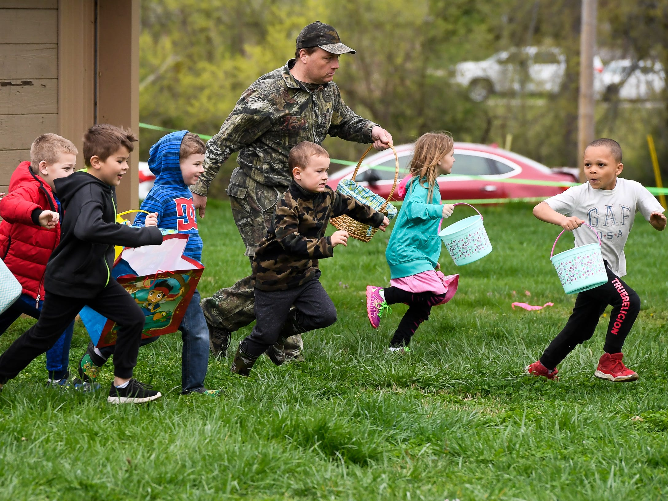 Children scramble for the more than 15,000 eggs hidden away in Community Park for the City of Henderson Parks and Recreation Department's annual Easter Egg Hunt Saturday, April 13, 2019.