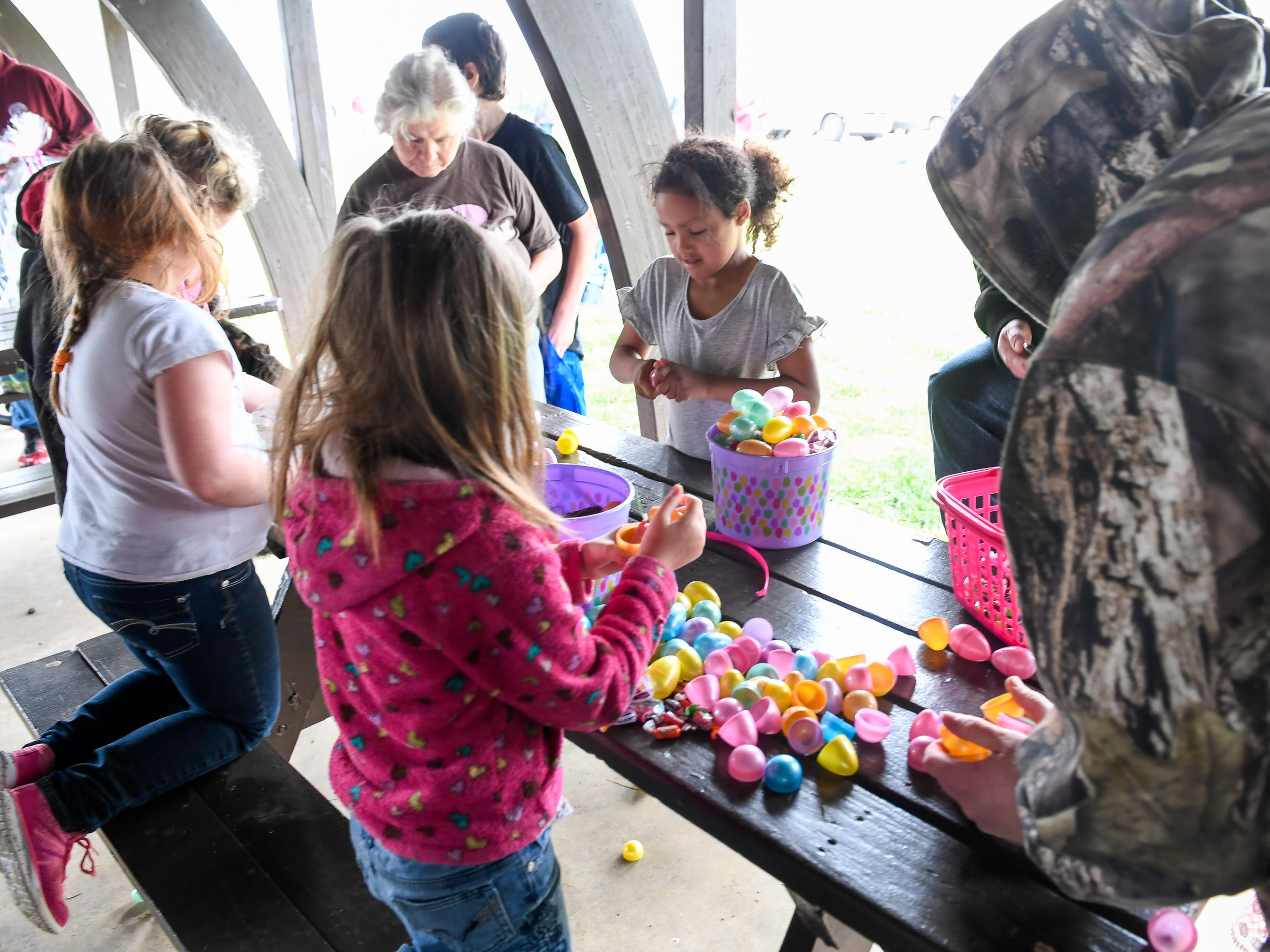 Children and parents look for prizes in the more than 15,000 eggs hidden away in Community Park for the City of Henderson Parks and Recreation Department's annual Easter Egg Hunt Saturday, April 13, 2019.