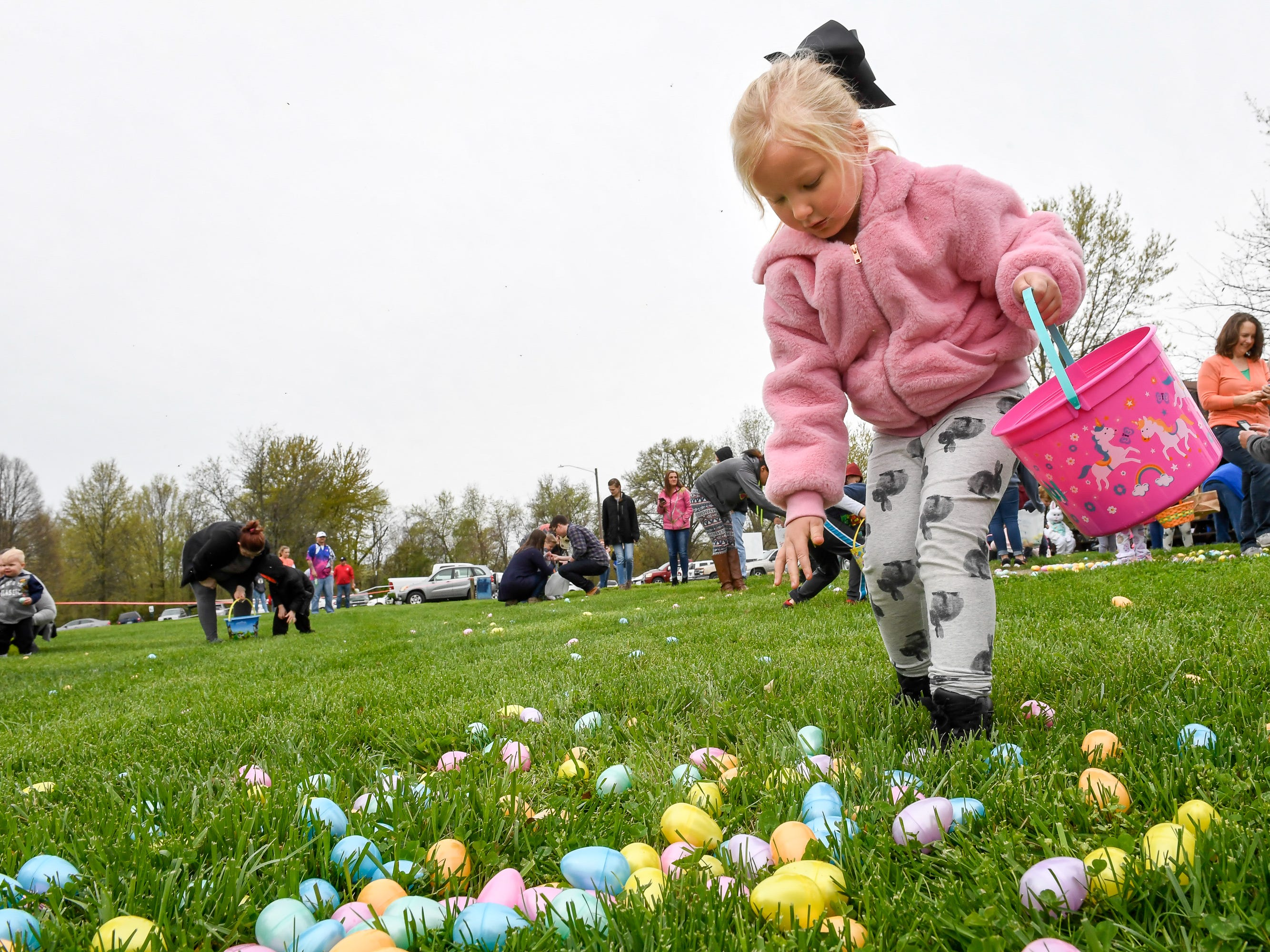 Sydni Hess, four years-old, hunts for the more than 15,000 eggs hidden away in Community Park for the City of Henderson Parks and Recreation Department's annual Easter Egg Hunt Saturday, April 13, 2019.