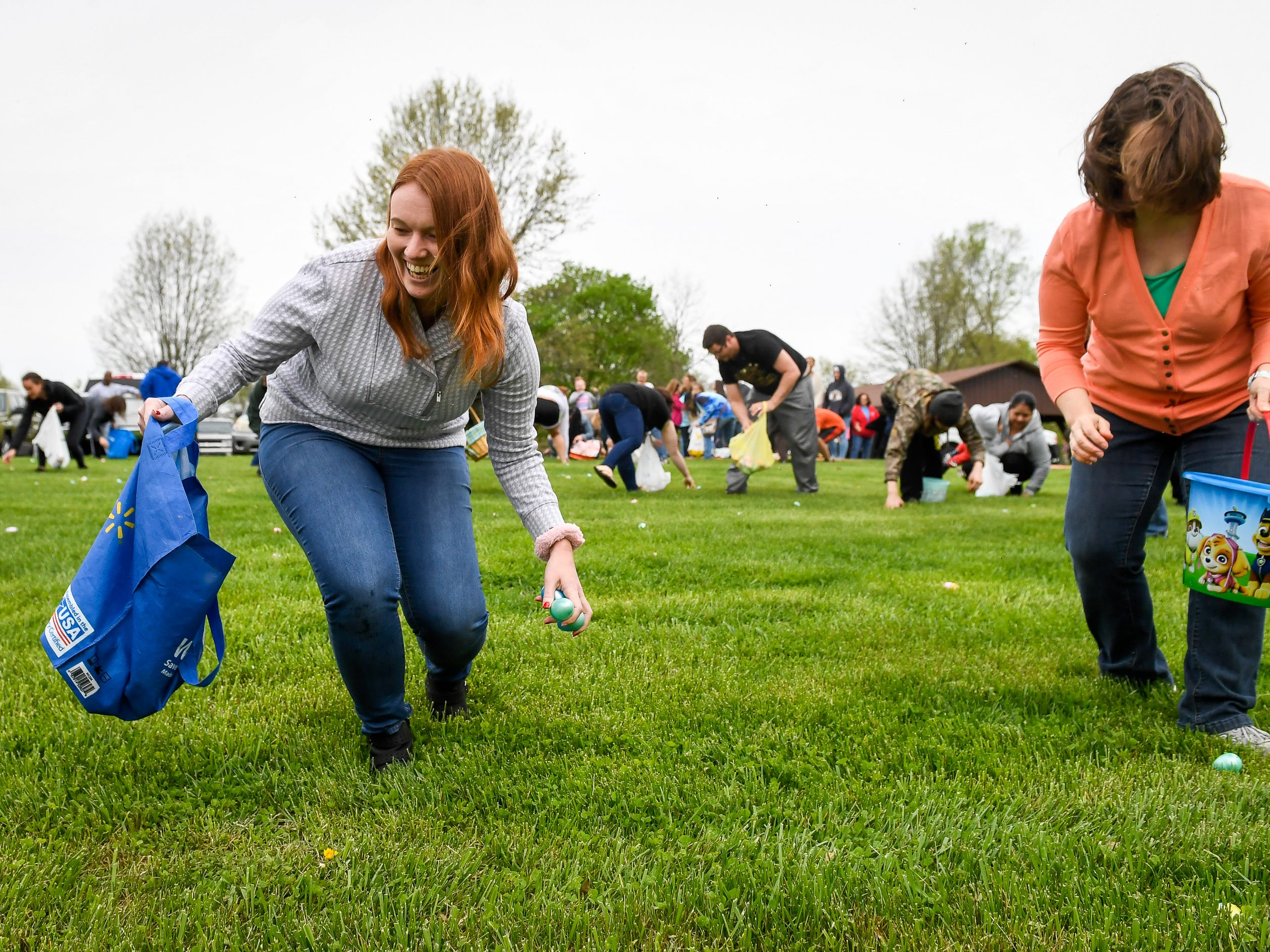 Halee Moscato, left, and Valerie Arvin look for eggs in the adult egg hunt at Community Park for the City of Henderson Parks and Recreation Department's annual Easter Egg Hunt Saturday, April 13, 2019.