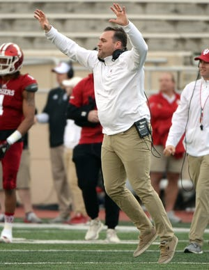 Indiana Hoosiers defensive coordinator Kane Wommack celebrates after the defense forced a turnover during the Cream-Crimson spring game at Memorial Stadium in Bloomington, Ind., on Friday, April 12, 2019.