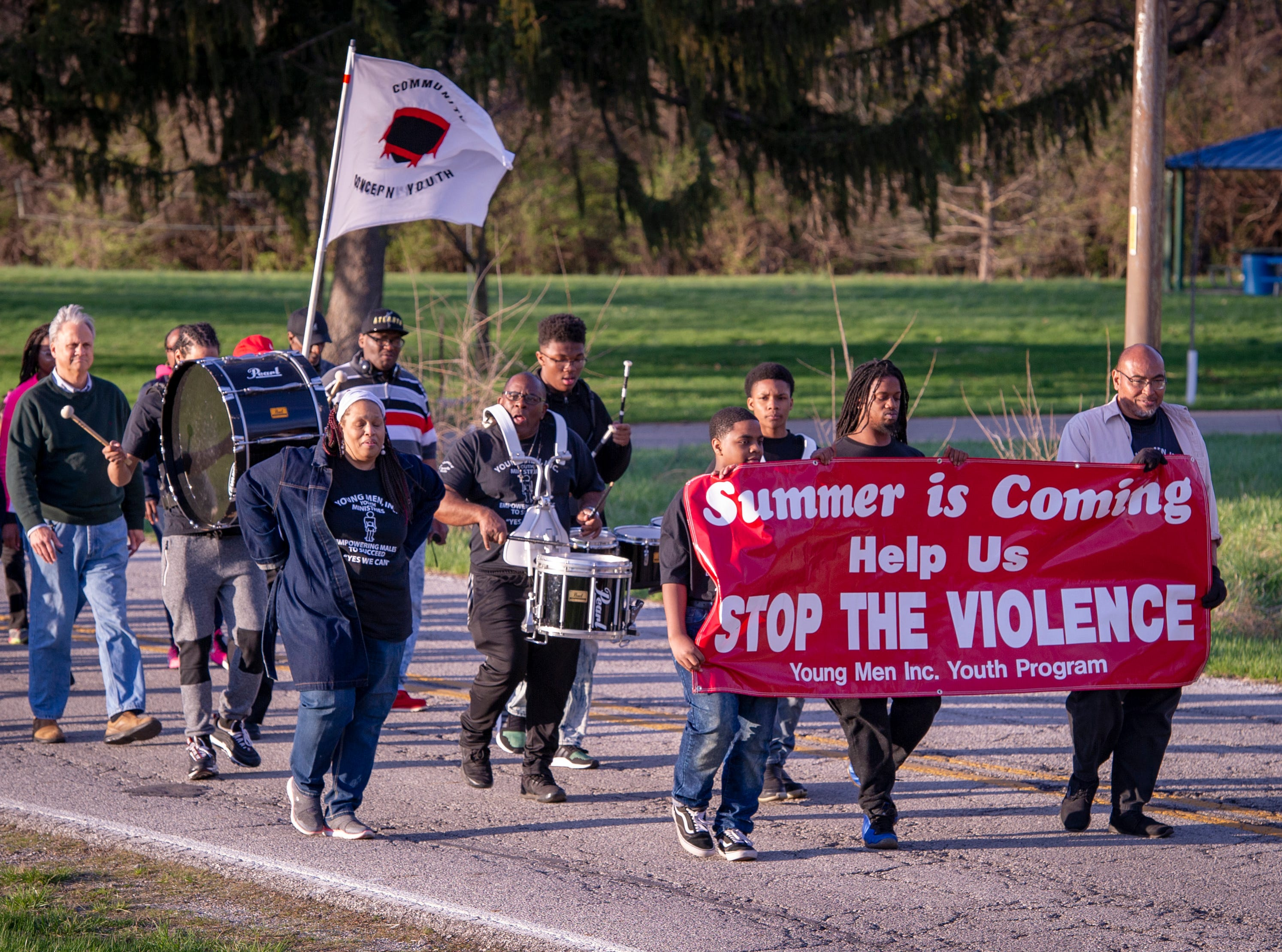 The Indianapolis Fraternal Order of Police, along with members of the Indy Ten Point Coalition, law enforcement officers from Southport, Lawrence, Cumberland police departments and a group of citizens participated in a peace walk, Friday, April 12, 2019. The groups organized in an effort to raise awareness for the increase of violence in the area of Washington Park on the northeast side of Indianapolis.