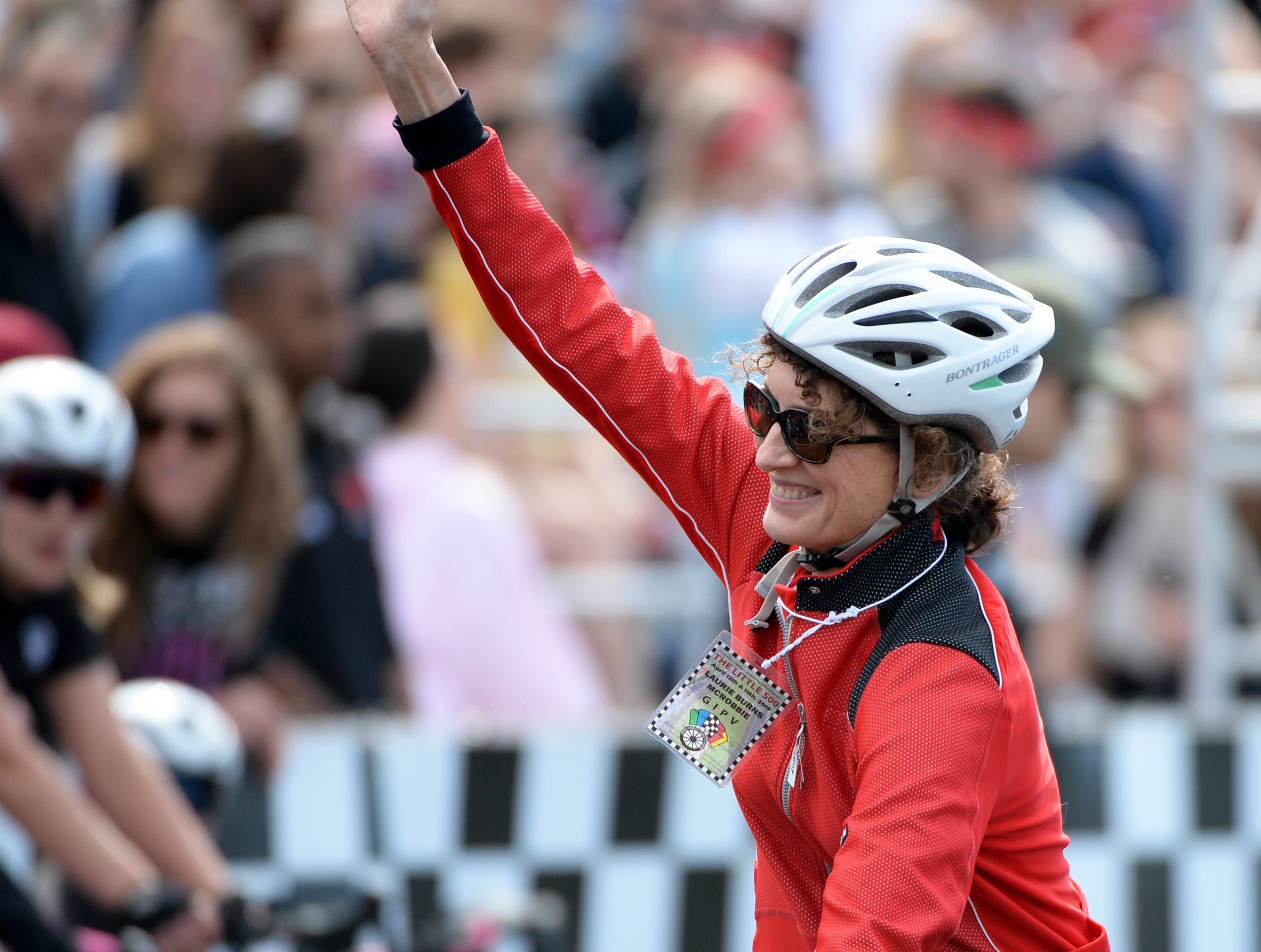IU First Lady Laurie McRobbie rides a lap prior to the start of the women's Little 500 at Bill Armstrong Stadium in Bloomington, Ind., on Friday, April 12, 2019.