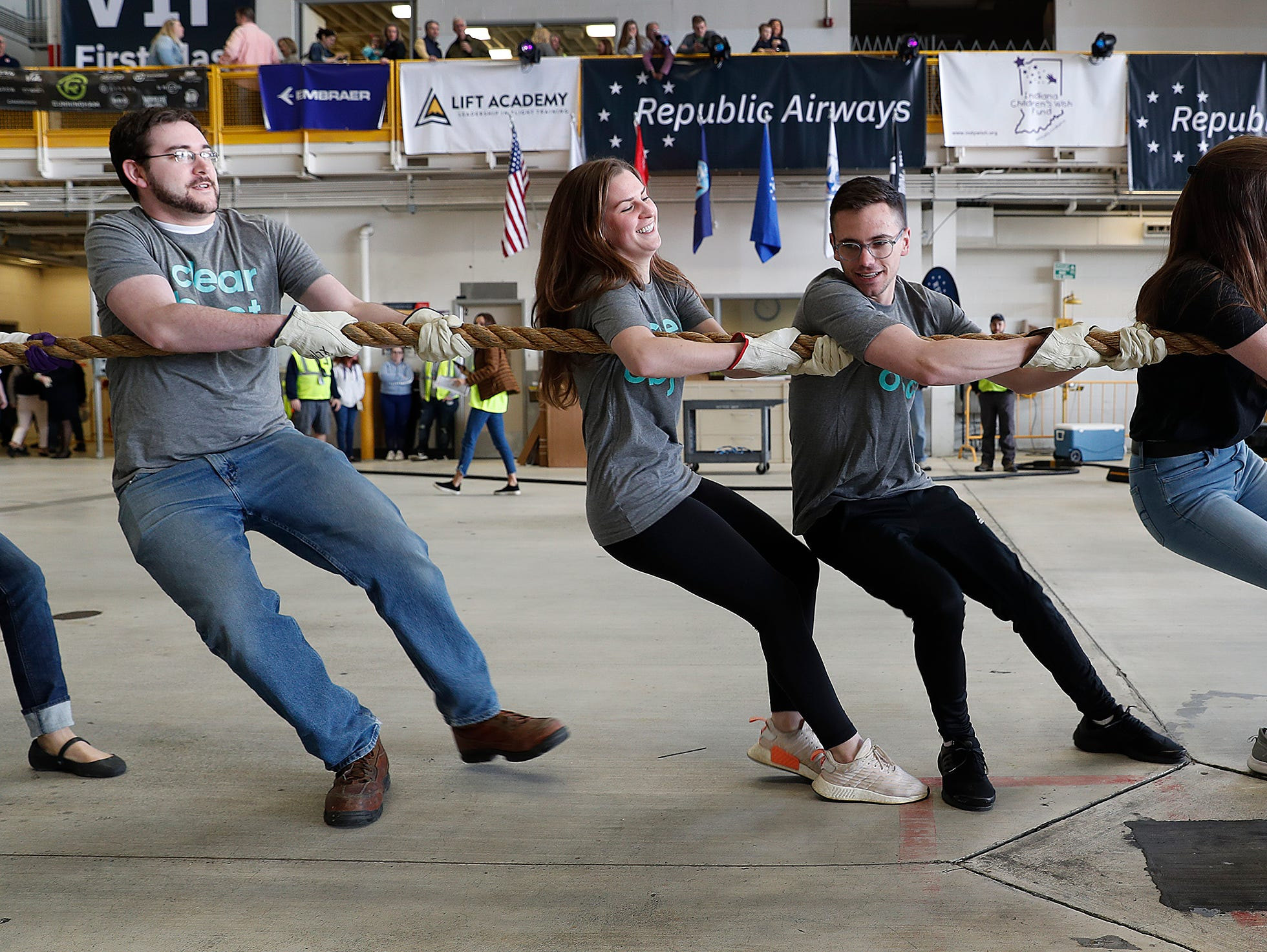 Team ClearObject pulls an Embraer 170/175 aircraft 15 feet during the 9th Annual Republic Airways Plane Pull at the Republic Airways Hanger at the Indianapolis International Airport on Saturday, April 13, 2019.