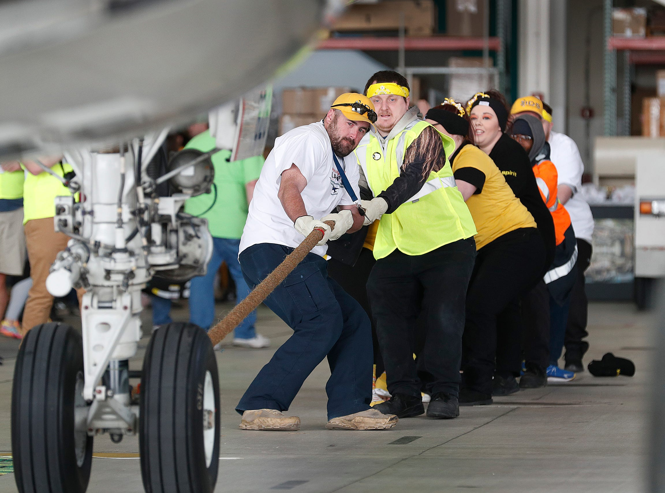 Team Spirit Airlines pulls an Embraer 170/175 aircraft 15 feet  during the 9th Annual Republic Airways Plane Pull at the Republic Airways Hanger at the Indianapolis International Airport on Saturday, April 13, 2019.