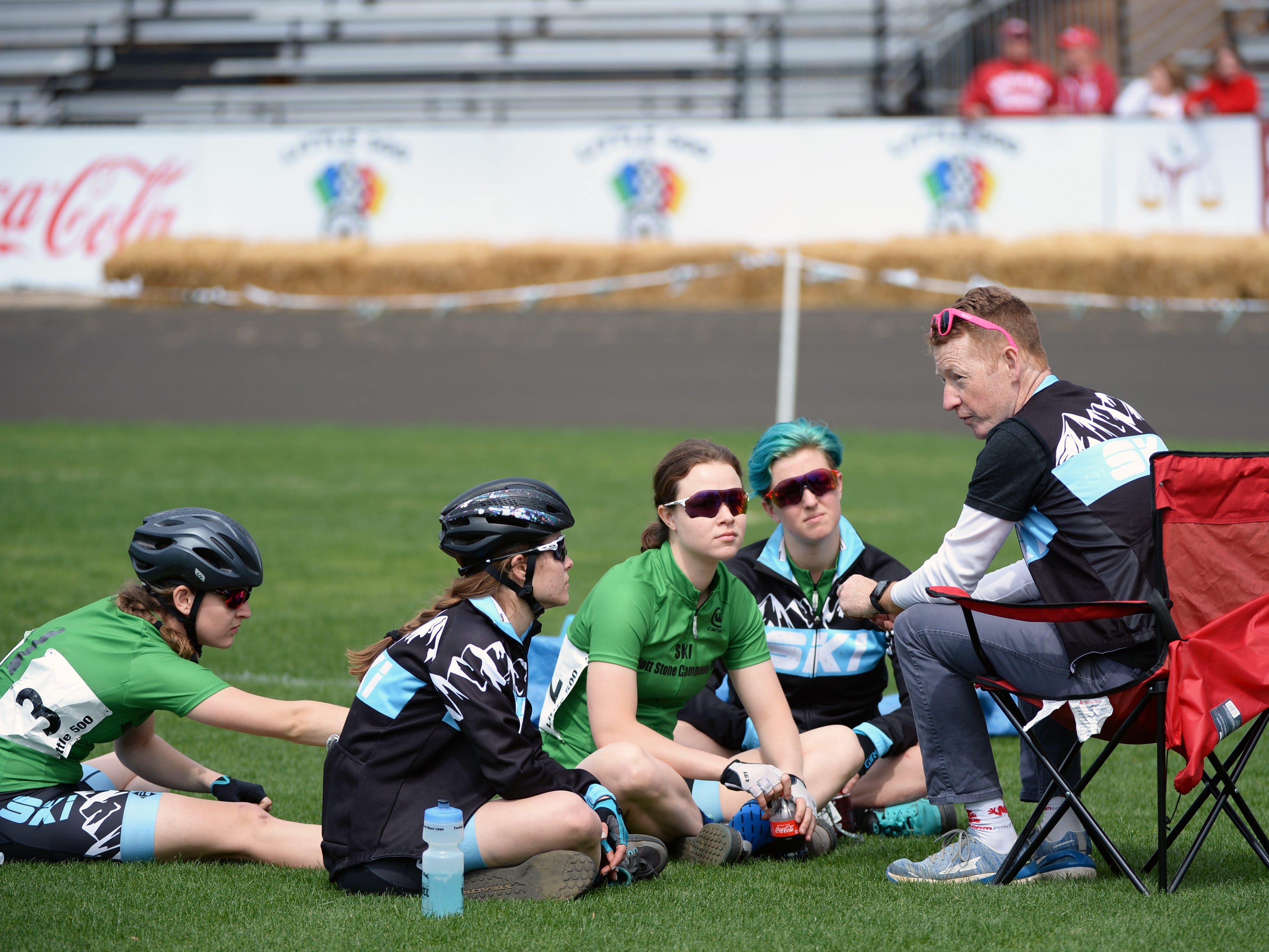 Ski talks with their coach prior to the start of the women's Little 500 at Bill Armstrong Stadium in Bloomington, Ind., on Friday, April 12, 2019.