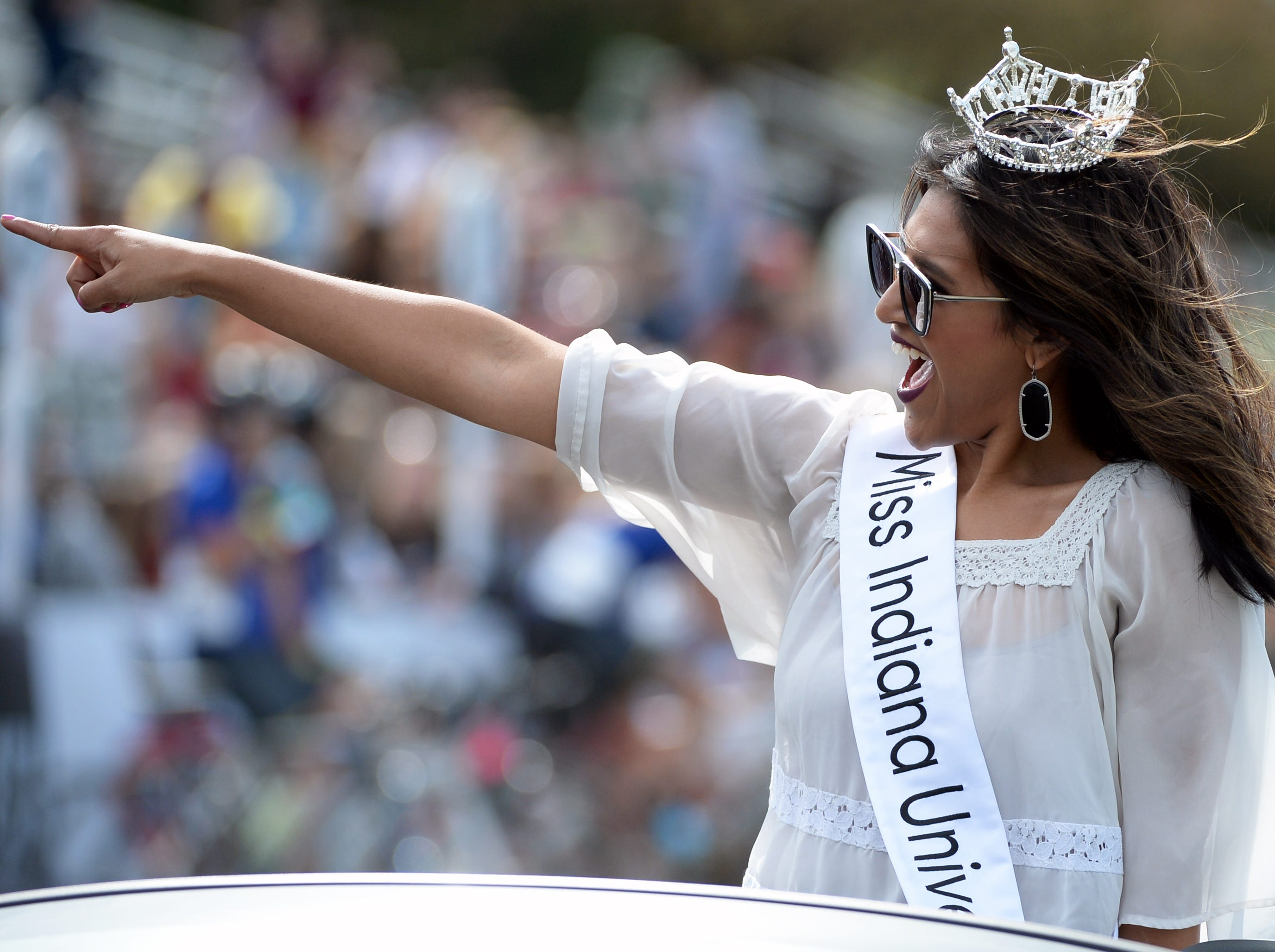 Miss Indiana University points to the crowd prior to the start of the women's Little 500 at Bill Armstrong Stadium in Bloomington, Ind., on Friday, April 12, 2019.