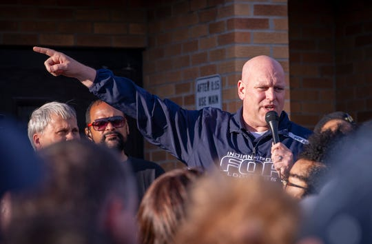 President of the Indianapolis Fraternal Order of Police, Rick Snyder talks to the crowd that gathered before the event. The Indianapolis Fraternal Order of Police, along with members of the Indy Ten Point Coalition, law enforcement officers from Southport, Lawrence, Cumberland police departments and a group of citizens participated in a peace walk, Friday, April 12, 2019.