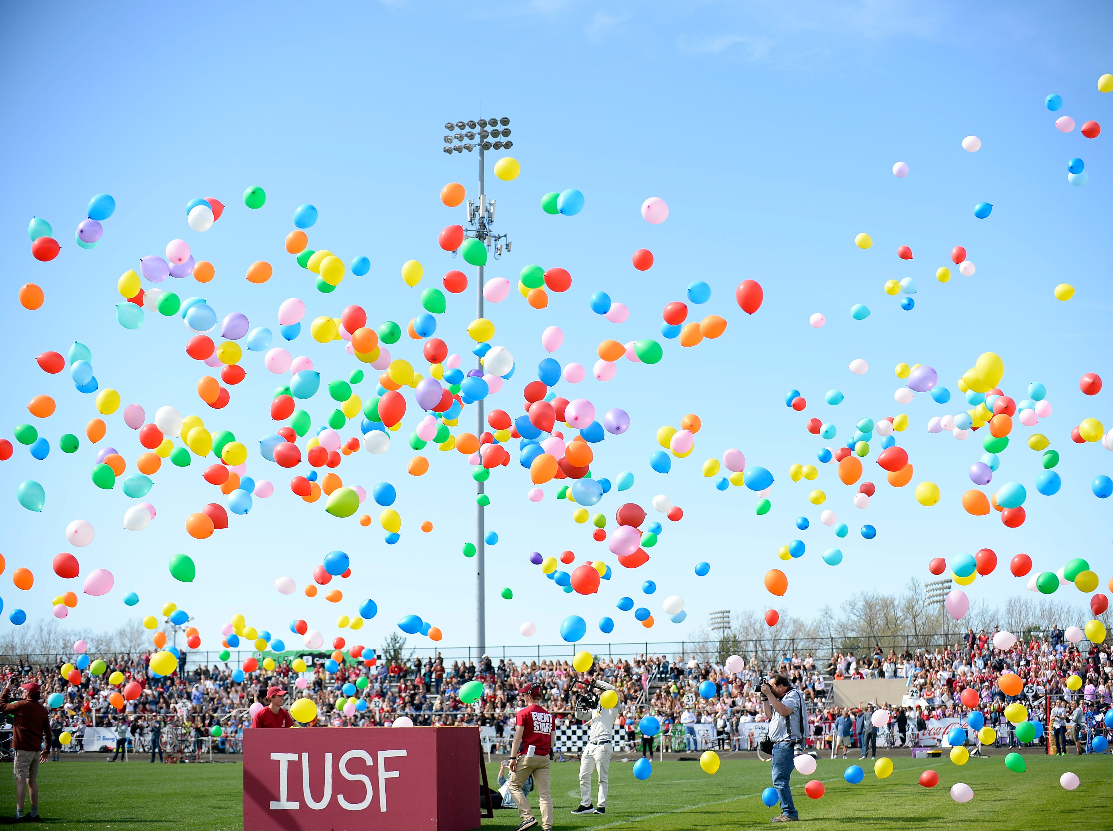 Balloons are released prior to the start of the women's Little 500 at Bill Armstrong Stadium in Bloomington, Ind., on Friday, April 12, 2019.