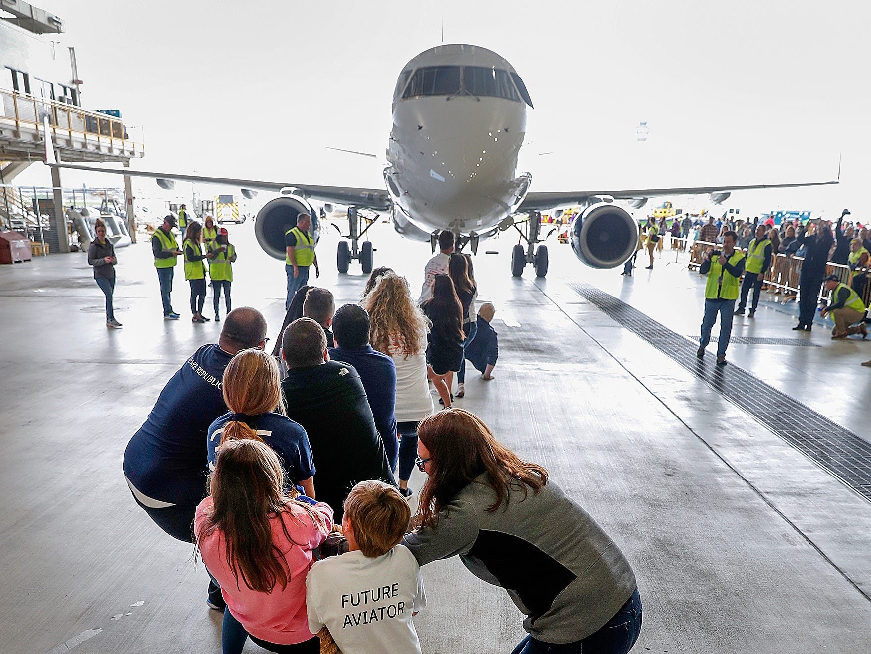The Puddle Jumpers pulls an Embraer 170/175 aircraft 15 feet during the 9th Annual Republic Airways Plane Pull at the Republic Airways Hanger at the Indianapolis International Airport on Saturday, April 13, 2019.
