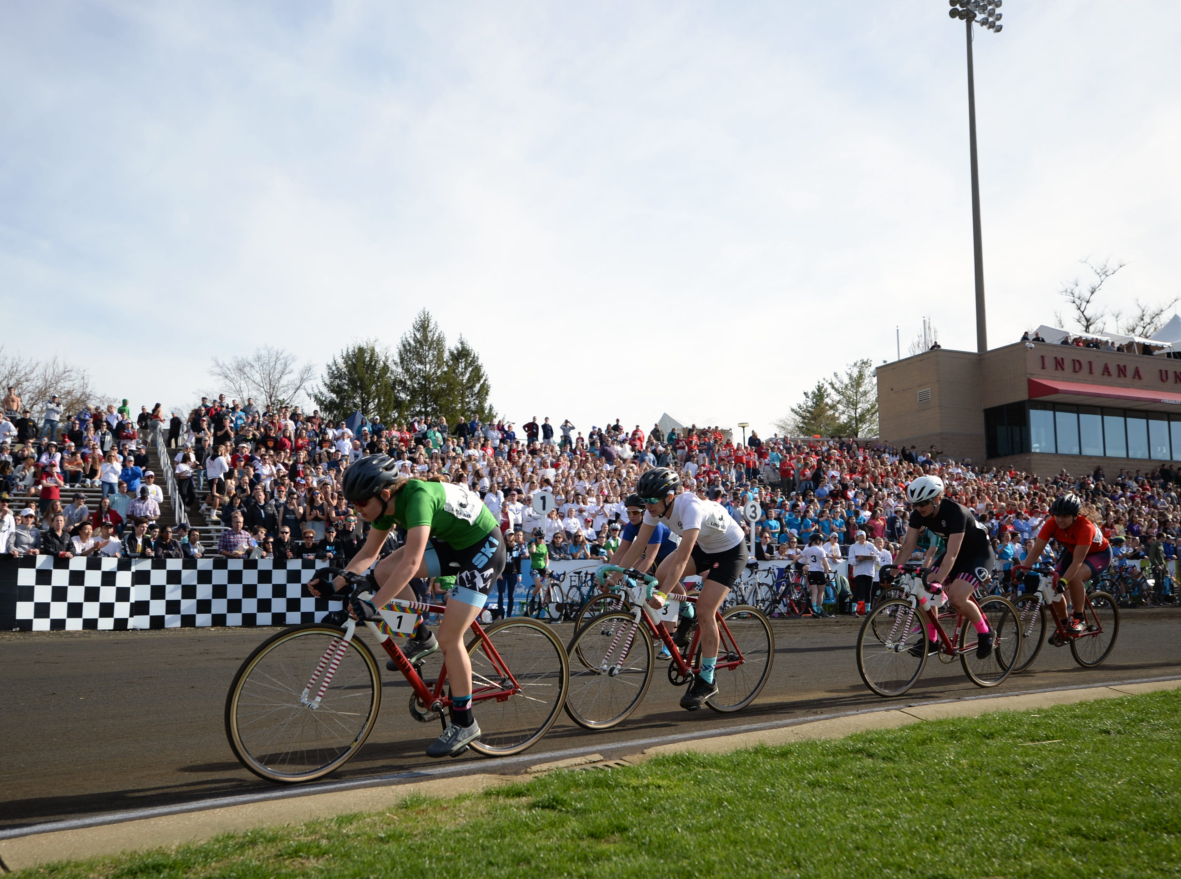 The lead pack during the women's Little 500 at Bill Armstrong Stadium in Bloomington, Ind., on Friday, April 12, 2019.