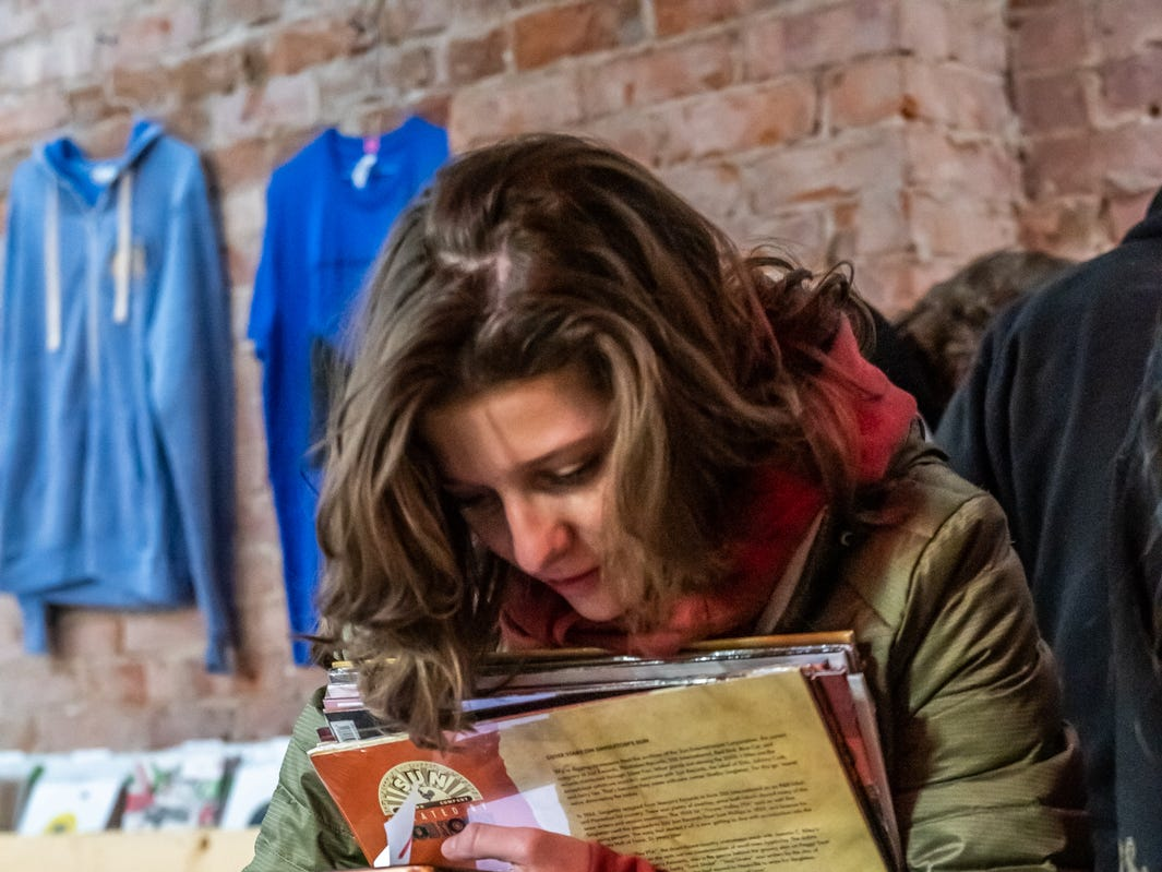 Hannah Horton looks through a collection of music during Record Store Day at Square Cat Vinyl.
