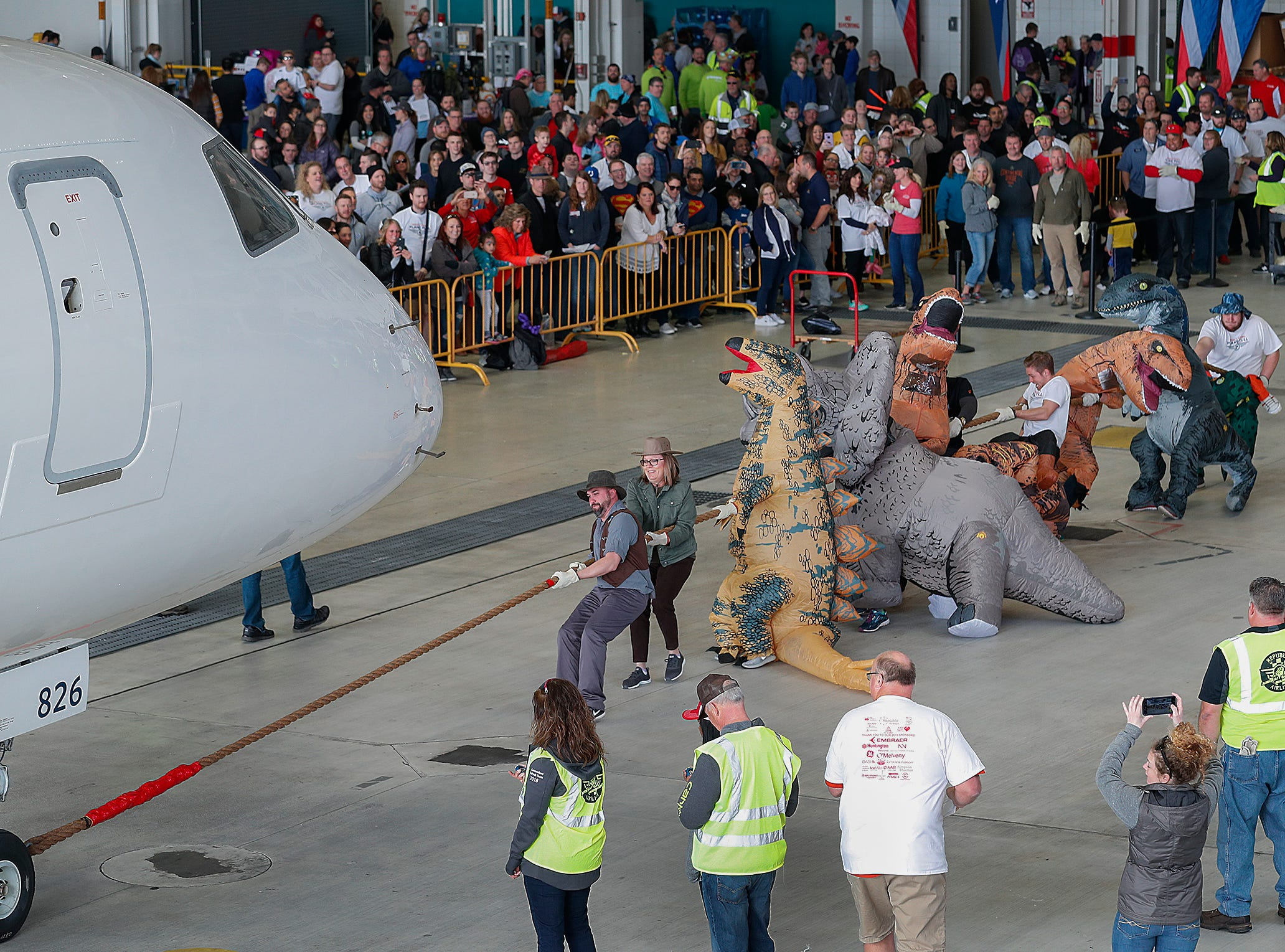 GE Aviation group pulls an Embraer 170/175 aircraft 15 feet during the 9th Annual Republic Airways Plane Pull at the Republic Airways Hanger at the Indianapolis International Airport on Saturday, April 13, 2019.