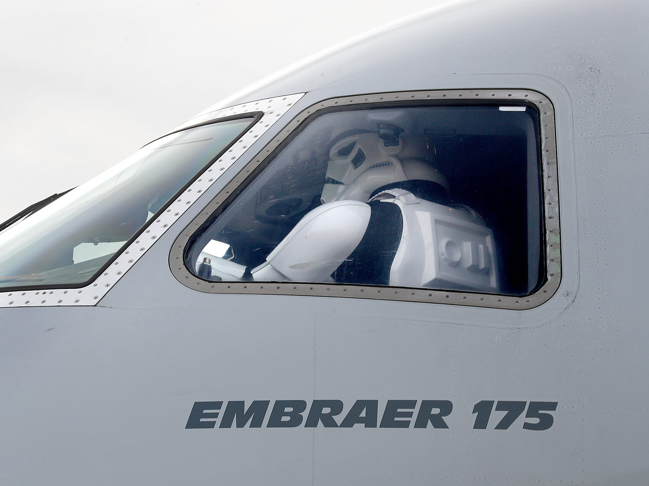 Members of the Star Wars 501st and Rebel Legion get a tour of the Embraer 175 American Eagle aircraft during the 9th Annual Republic Airways Plane Pull at the Republic Airways Hanger at the Indianapolis International Airport on Saturday, April 13, 2019.