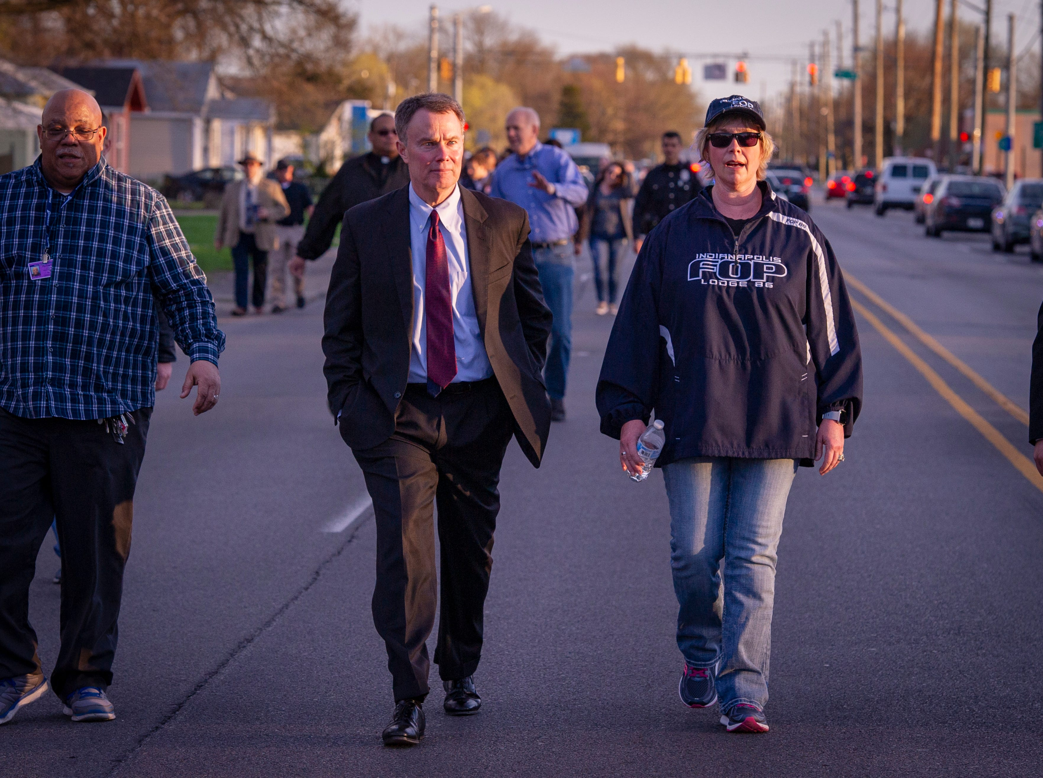Indianapolis Mayor Joseph Hogsett said he was participating in the event as a citizen not as the mayor. The Indianapolis Fraternal Order of Police, along with members of the Indy Ten Point Coalition, law enforcement officers from Southport, Lawrence, Cumberland police departments and a group of citizens participated in a peace walk, Friday, April 12, 2019. The groups organized in an effort to raise awareness for the increase of violence in the area of Washington Park on the northeast side of Indianapolis.