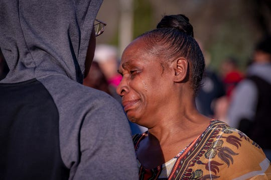 The grandmother of a victim of this past week's shootings, Aleasha Ross, becomes emotional while talking to supporters before the event. The Indianapolis Fraternal Order of Police, along with members of the Indy Ten Point Coalition, law enforcement officers from Southport, Lawrence, Cumberland police departments and a group of citizens participated in a peace walk, Friday, April 12, 2019. The groups organized in an effort to raise awareness for the increase of violence in the area of Washington Park on the northeast side of Indianapolis.