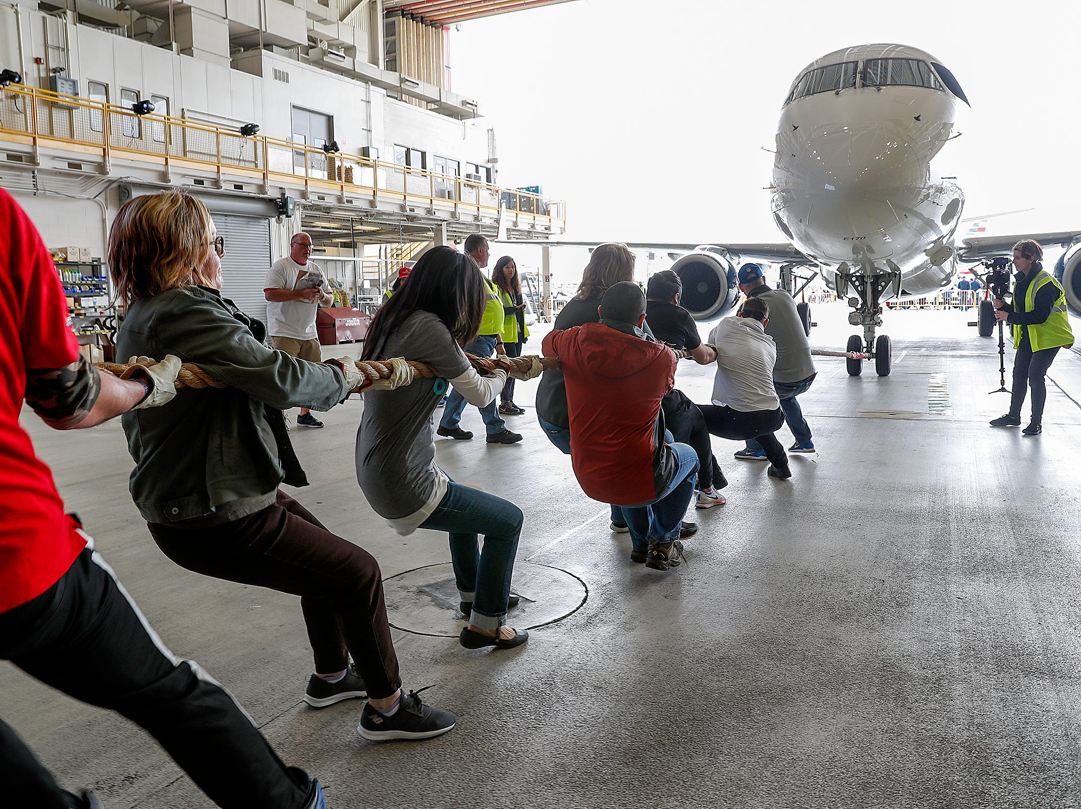Team Expediant pulls an Embraer 170/175 aircraft 15 feet during the 9th Annual Republic Airways Plane Pull at the Republic Airways Hanger at the Indianapolis International Airport on Saturday, April 13, 2019.