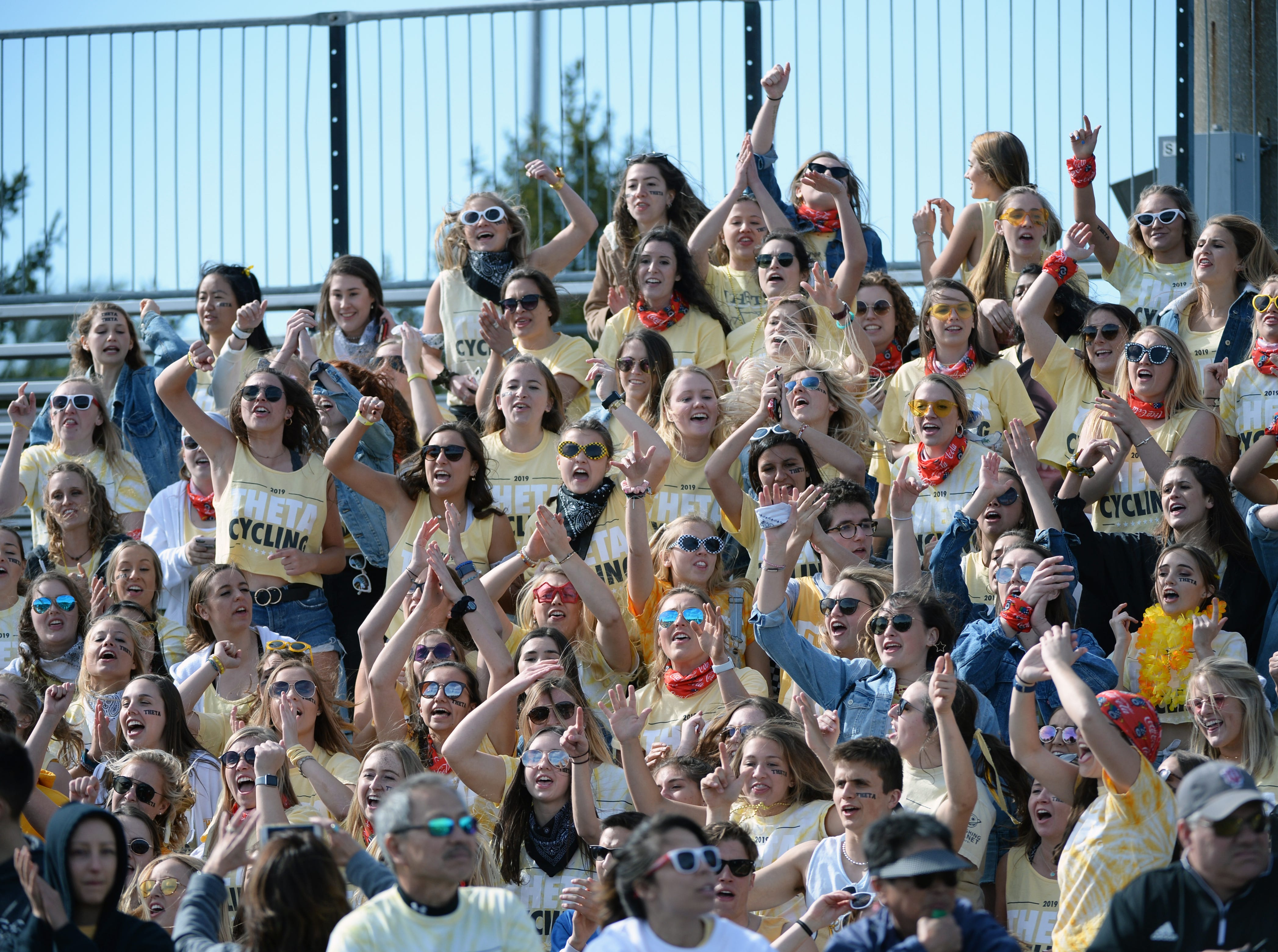 Kappa Alpha Theta fans cheer during the women's Little 500 at Bill Armstrong Stadium in Bloomington, Ind., on Friday, April 12, 2019.