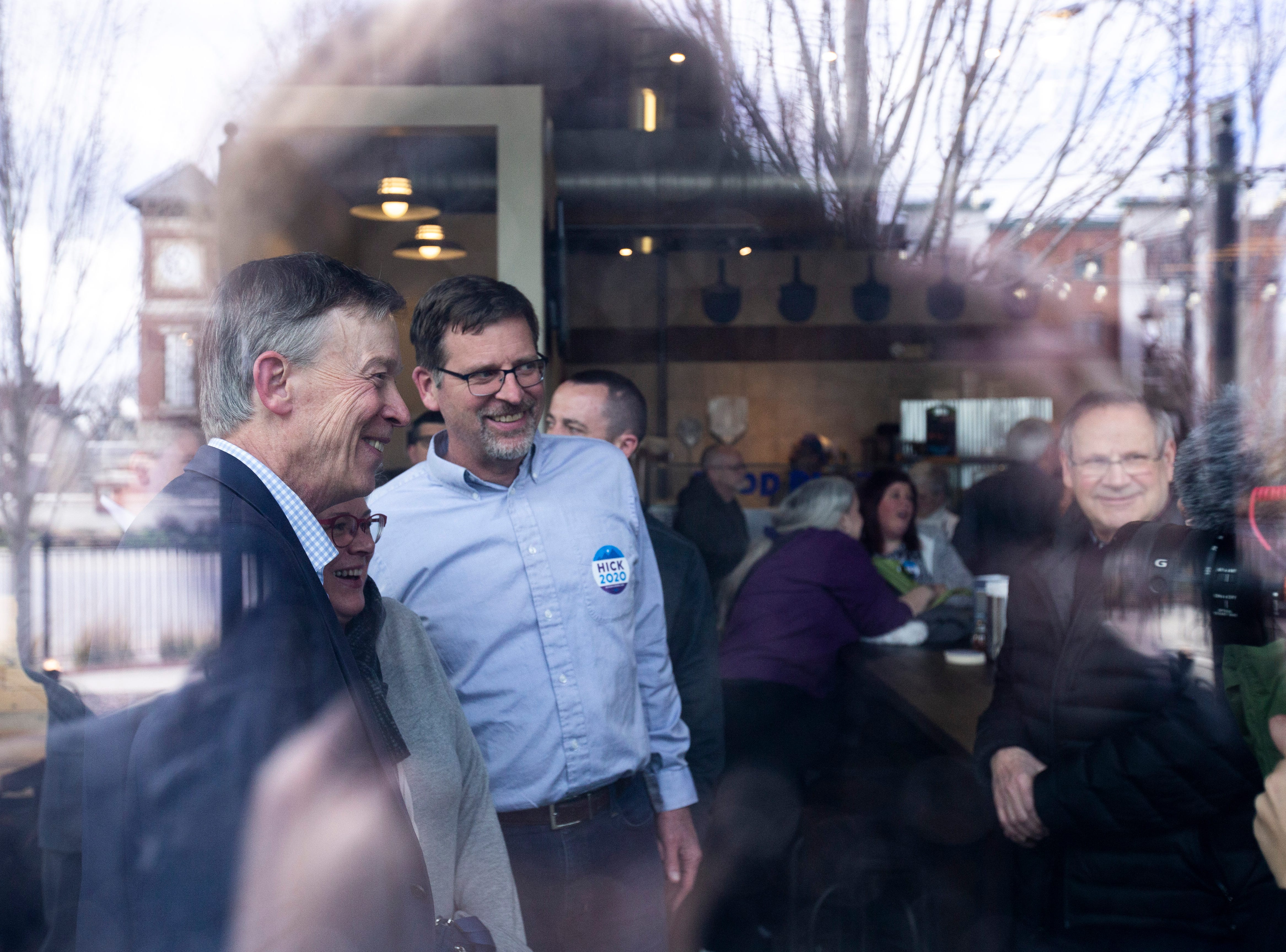 Democratic presidential candidate and former Colorado Gov. John Hickenlooper poses for photos after an event on Friday, April 12, 2019, at Backpocket Brewing in Coralville, Iowa.