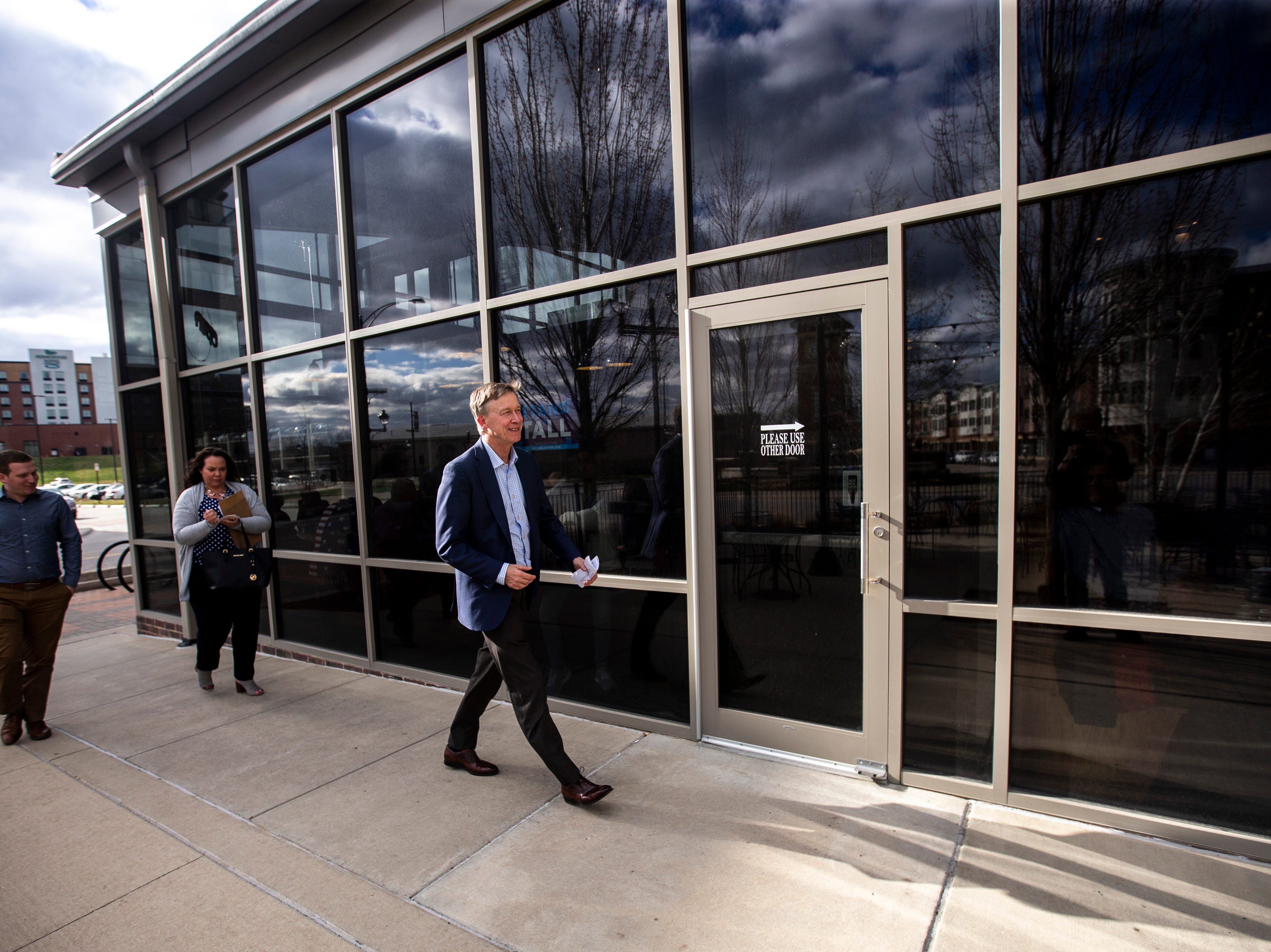 Democratic presidential candidate and former Colorado Gov. John Hickenlooper arrives at an event on Friday, April 12, 2019, at Backpocket Brewing in Coralville, Iowa.