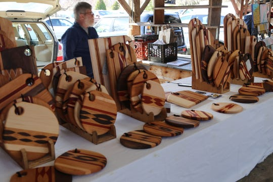 William Baker, of Plum Creek Designs, sells handcrafted cutting boards and boards that can be used for serving cheese and crackers.