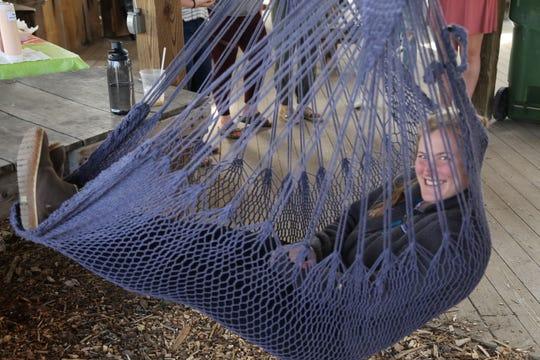Maggie Owen, a Cornell University student, lays in a hammock.