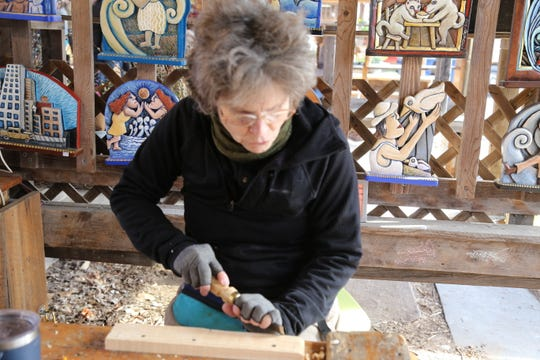 Mary Michael Shelley of Folk Art Mary makes handcarved carvings.