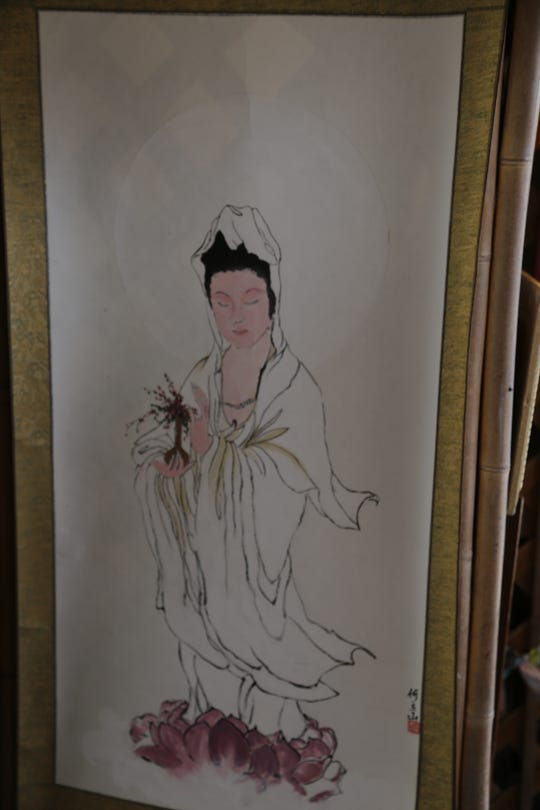 Jim Hardesty, of Dancing Brush Designs, makes Chinese paintings