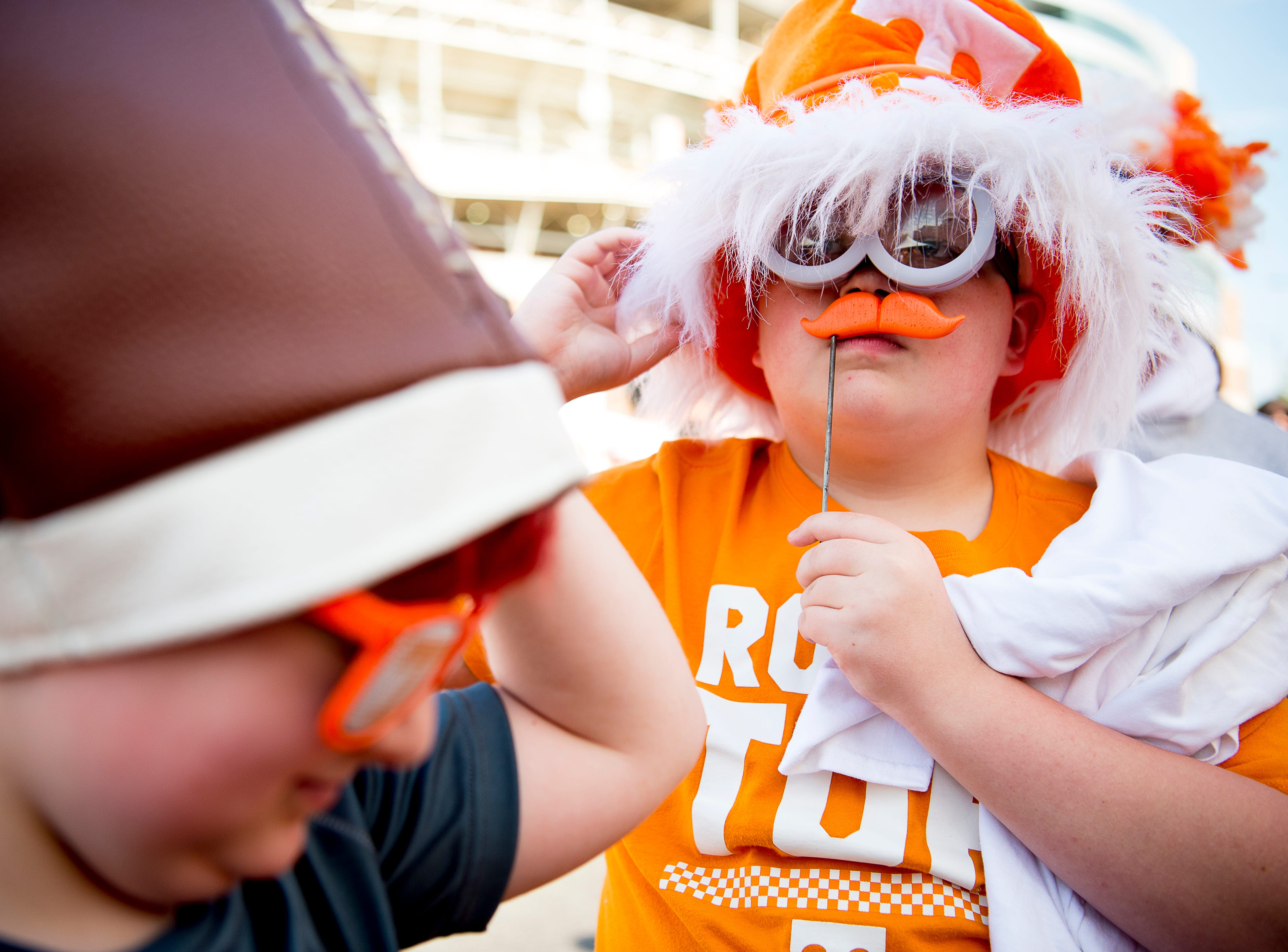 Brady Partin, right, and Ryan Jeffers, both from Jellico, put on their Tennessee gear at the Tennessee Spring Game at Neyland Stadium in Knoxville, Tennessee on Saturday, April 13, 2019.