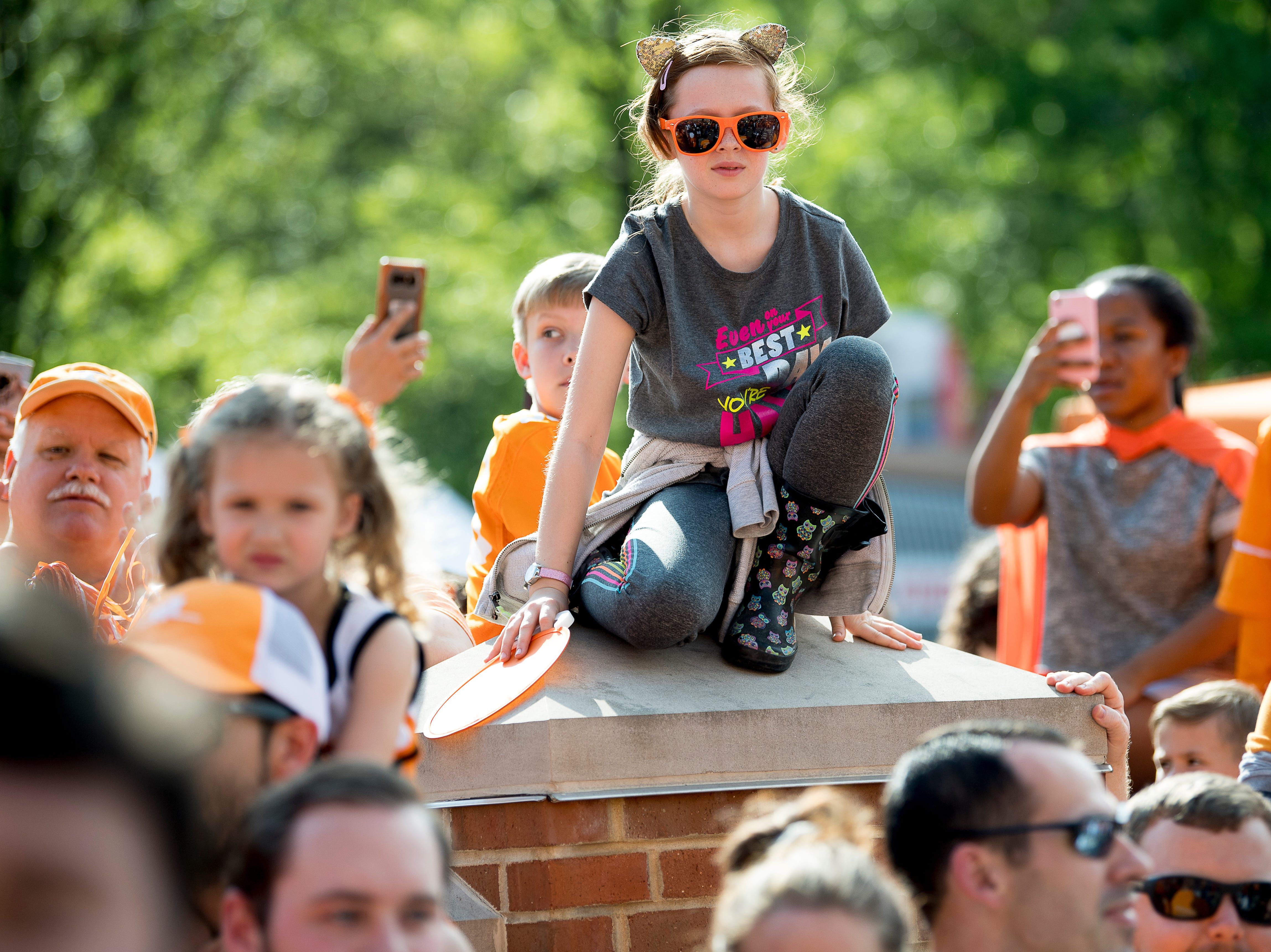 A fan gets a better view during the Vol Walk at the Tennessee Spring Game at Neyland Stadium in Knoxville, Tennessee on Saturday, April 13, 2019.