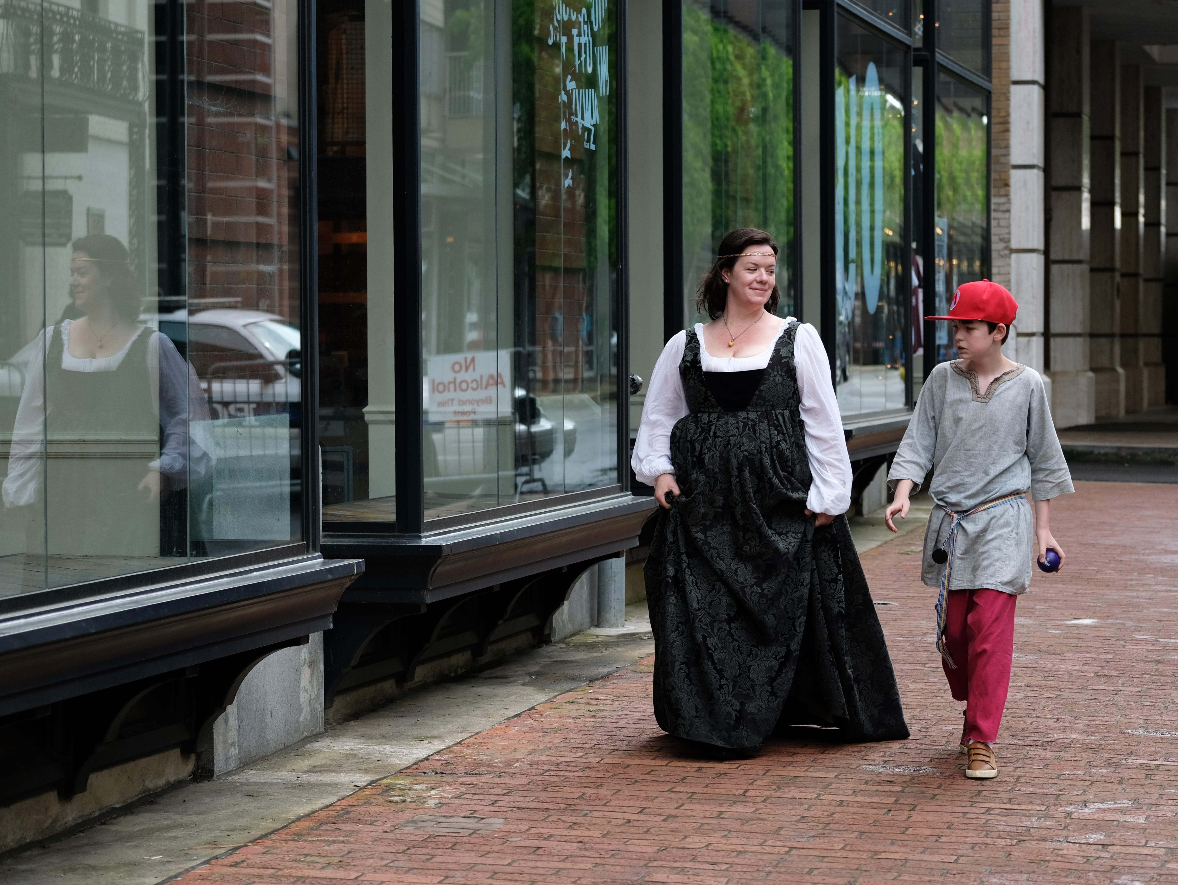 Shannon Bryant and Daniel Carey, 11, make their way to the Rossini Festival in Knoxville on Saturday, April 13, 2019. 