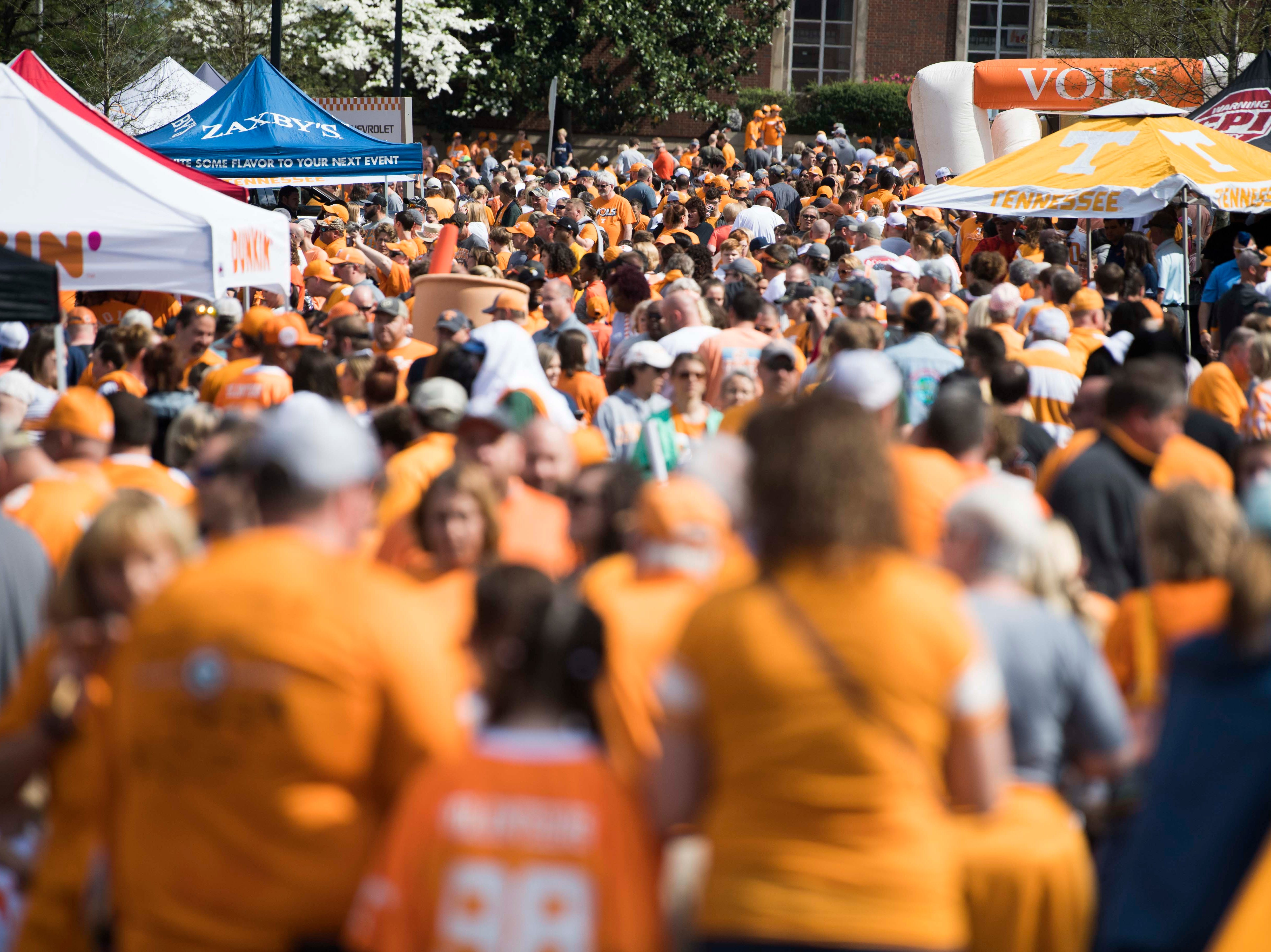 Fans wait for the Vols spring game to begin outside Neyland Stadium in Knoxville Saturday, April 13, 2019.