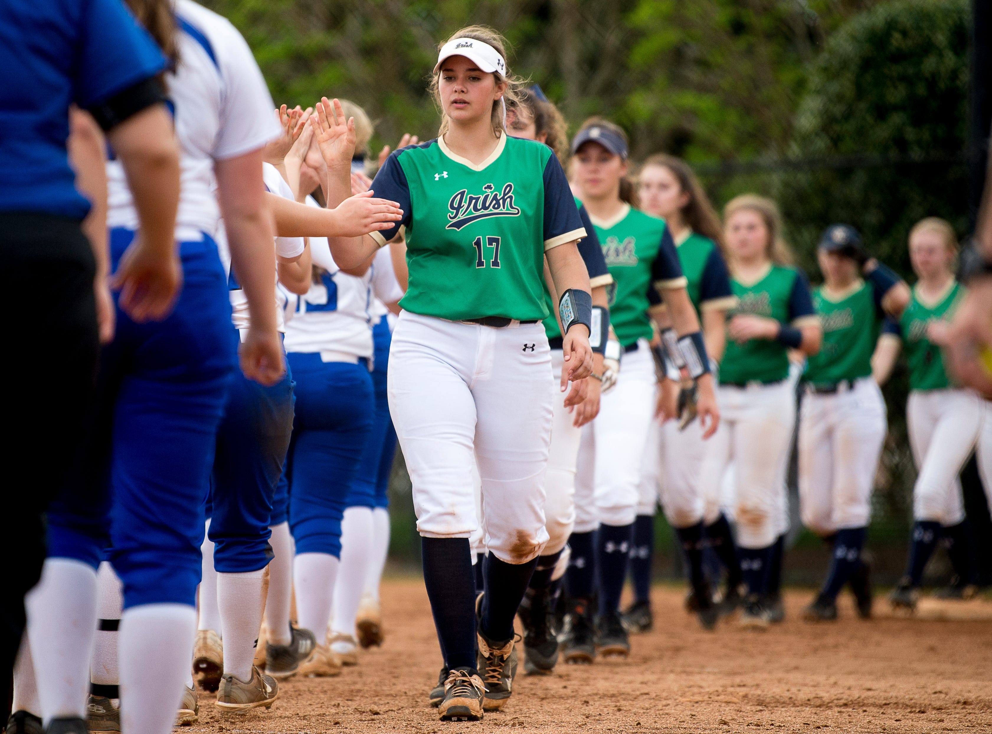 Players shake hands after a softball game between Catholic and Karns at Caswell Park in Knoxville, Tennessee on Friday, April 12, 2019.