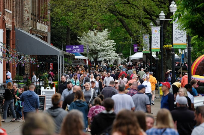 Festivalgoers make their way through the Rossini Festival in Knoxville on Saturday, April 13, 2019.  (Shawn Millsaps/Special to News Sentinel)