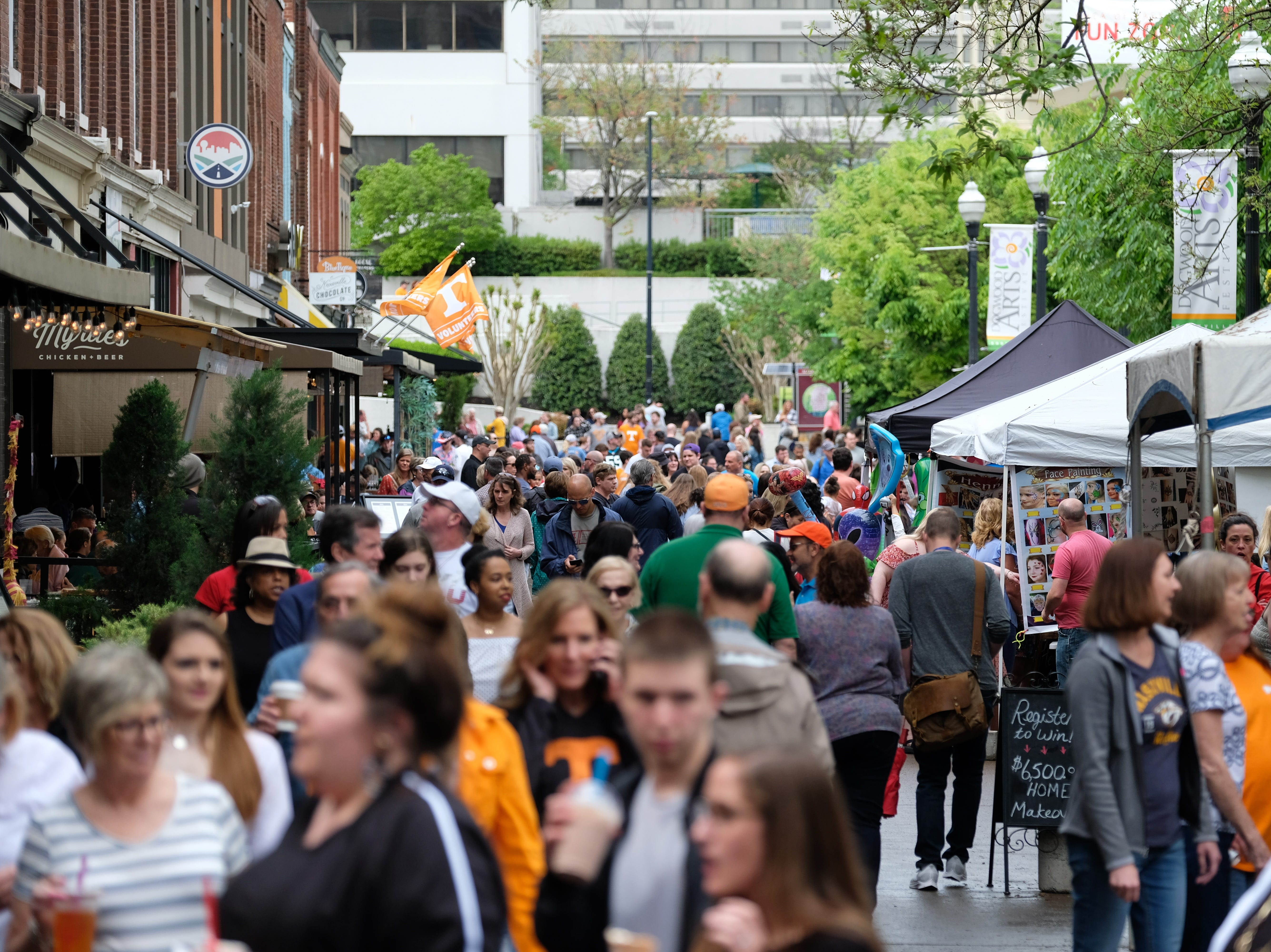 Festival goers make their way through the Rossini Festival in Knoxville on Saturday, April 13, 2019. 