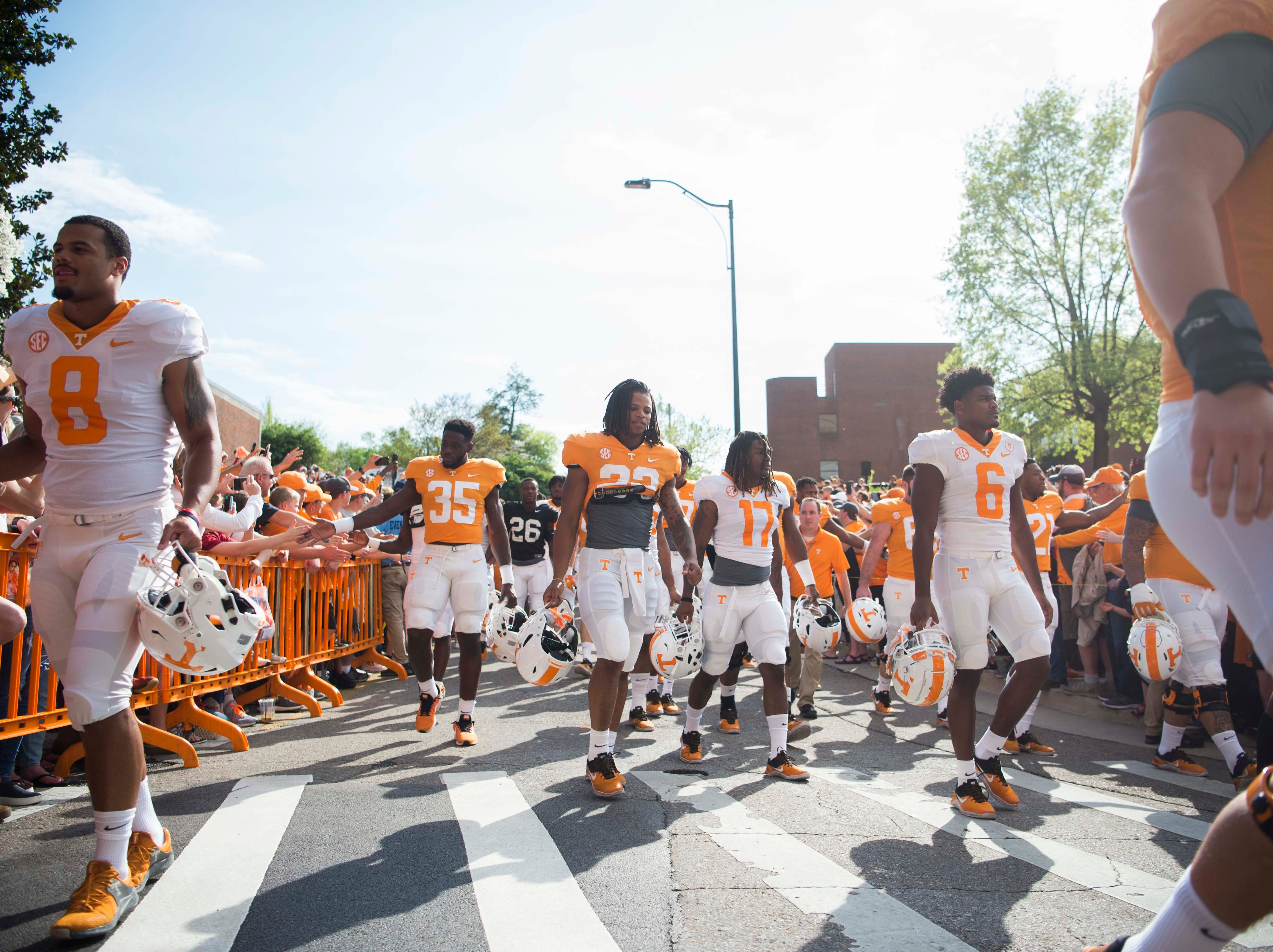 Tennessee players walk in the Vol walk outside Neyland Stadium in Knoxville Saturday, April 13, 2019.