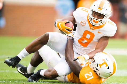 Tennessee linebacker Shanon Reid (21)  takes down Tennessee running back Ty Chandler (8) during the Vols spring game in Neyland Stadium in Knoxville Saturday, April 13, 2019.