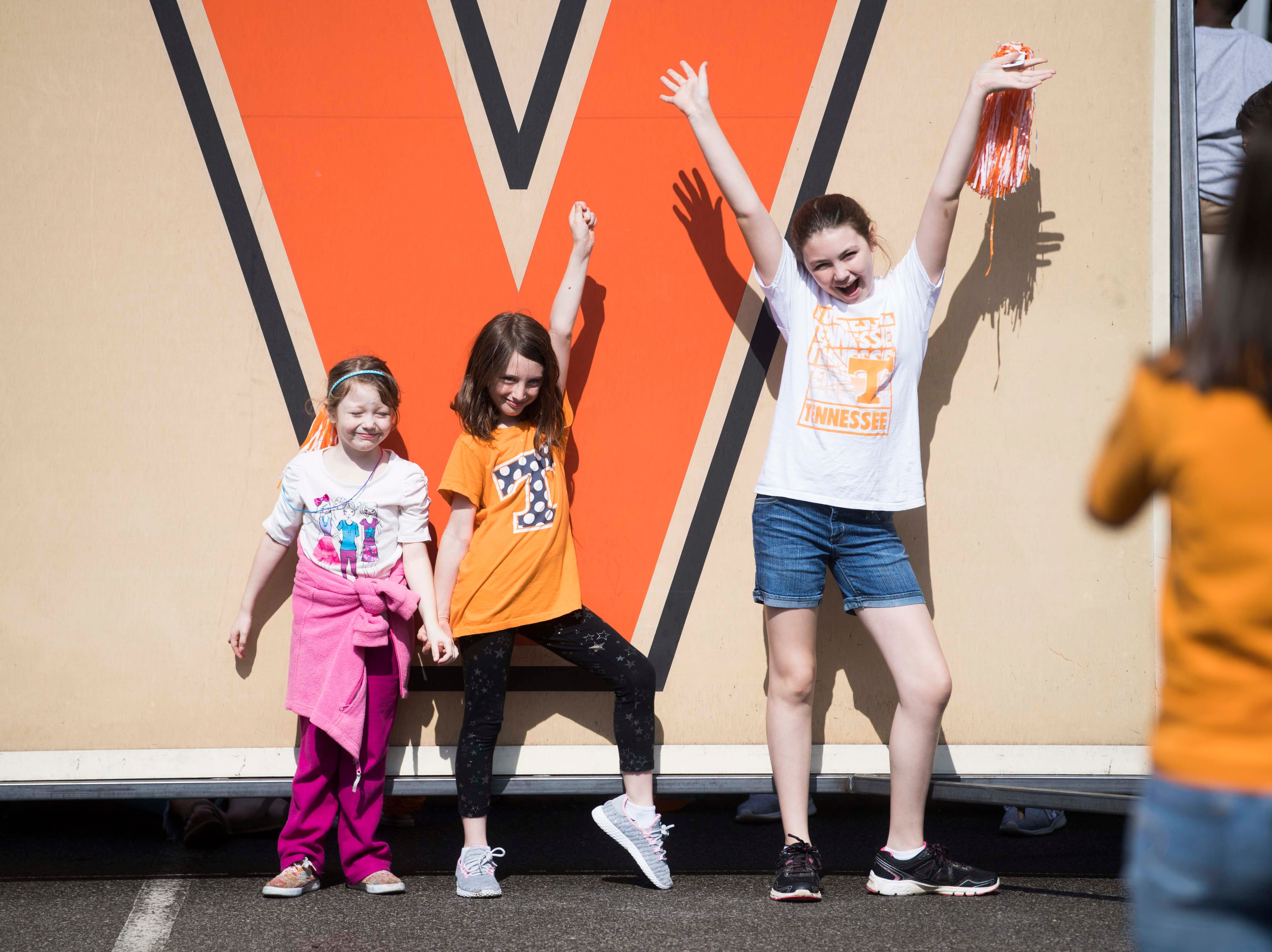 Young fans pose for a photos while waiting for the Vols spring game to begin outside Neyland Stadium in Knoxville Saturday, April 13, 2019.