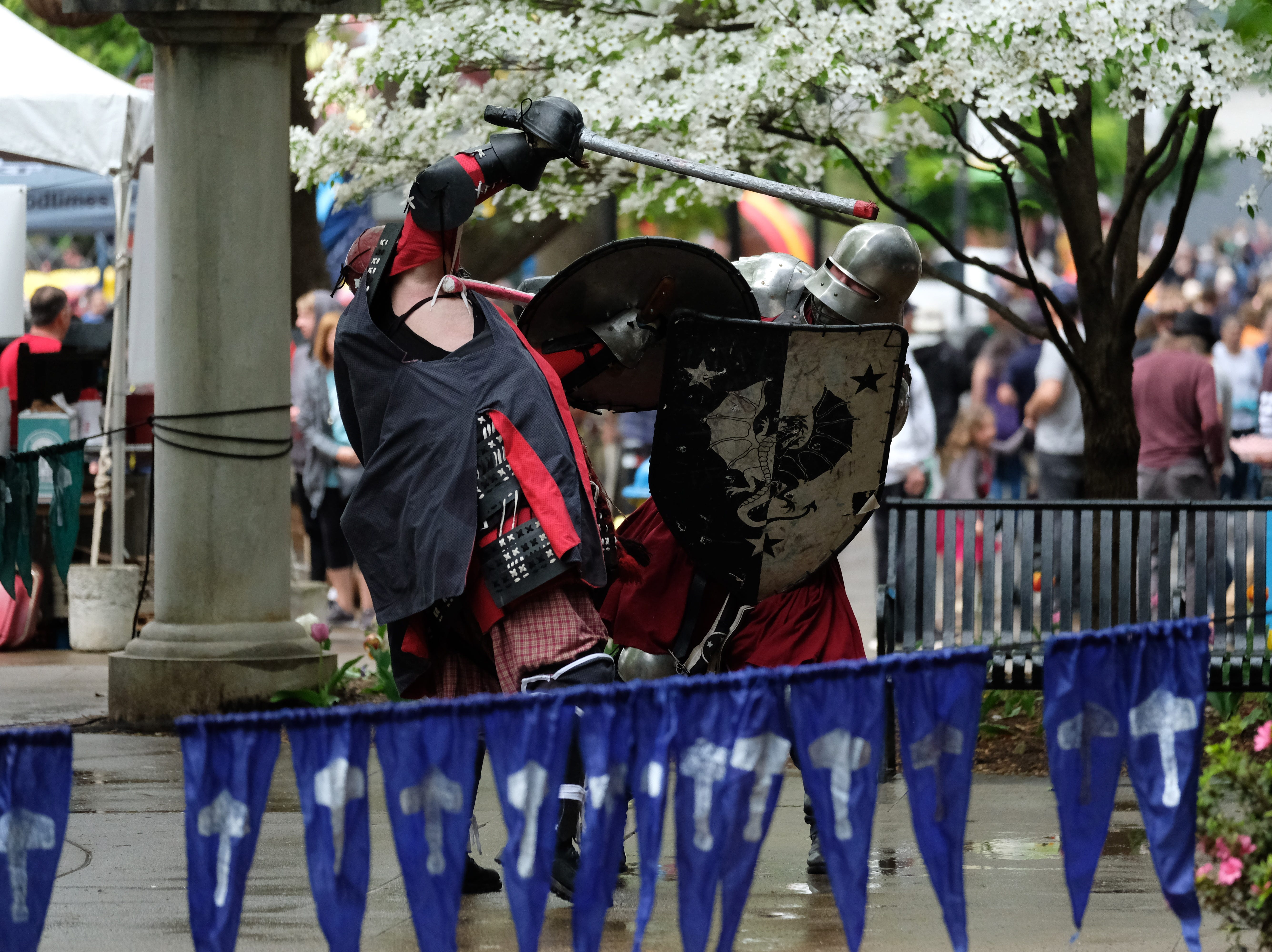 The Society for Creative Anachronism demonstrates sword fighting during the Rossini Festival in Knoxville on Saturday, April 13, 2019. (Shawn Millsaps/Special to News Sentinel)