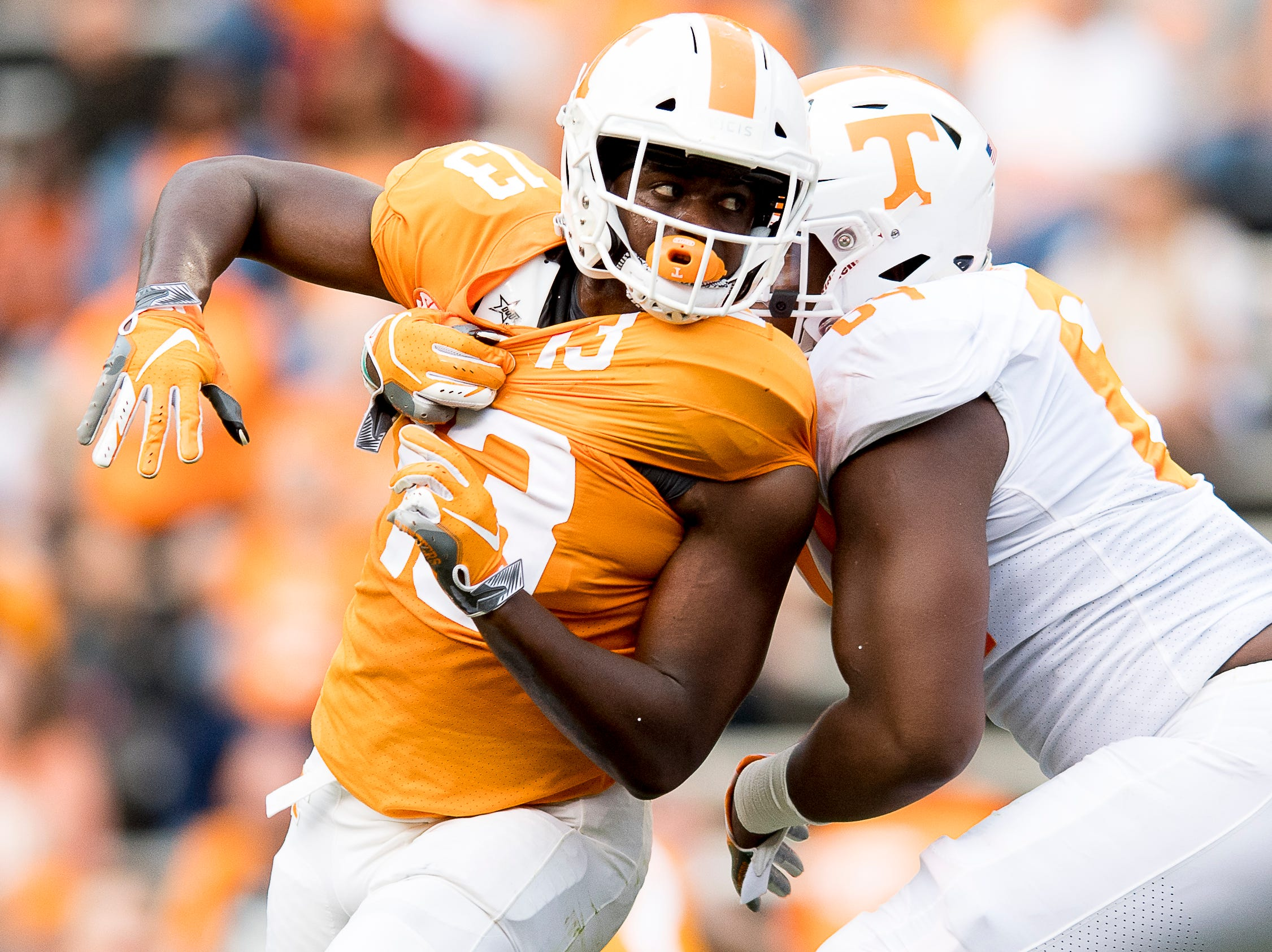 Tennessee linebacker Deandre Johnson tries to get around Tennessee offensive lineman Wanya Morris (64) during the Tennessee Spring Game at Neyland Stadium in Knoxville, Tennessee on Saturday, April 13, 2019.