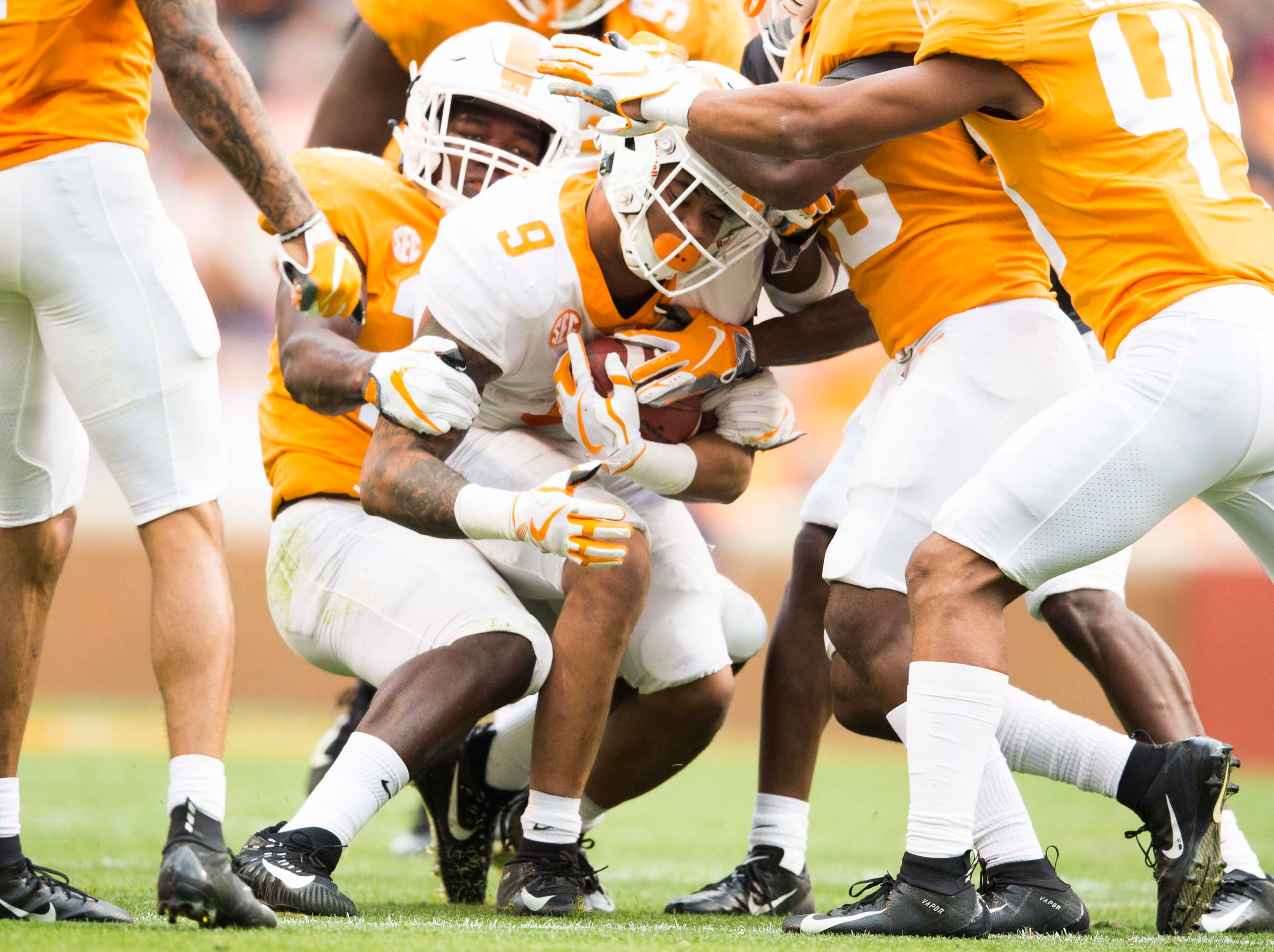 Tennessee running back Tim Jordan (9) is tackled during the Vols spring game in Neyland Stadium in Knoxville Saturday, April 13, 2019.