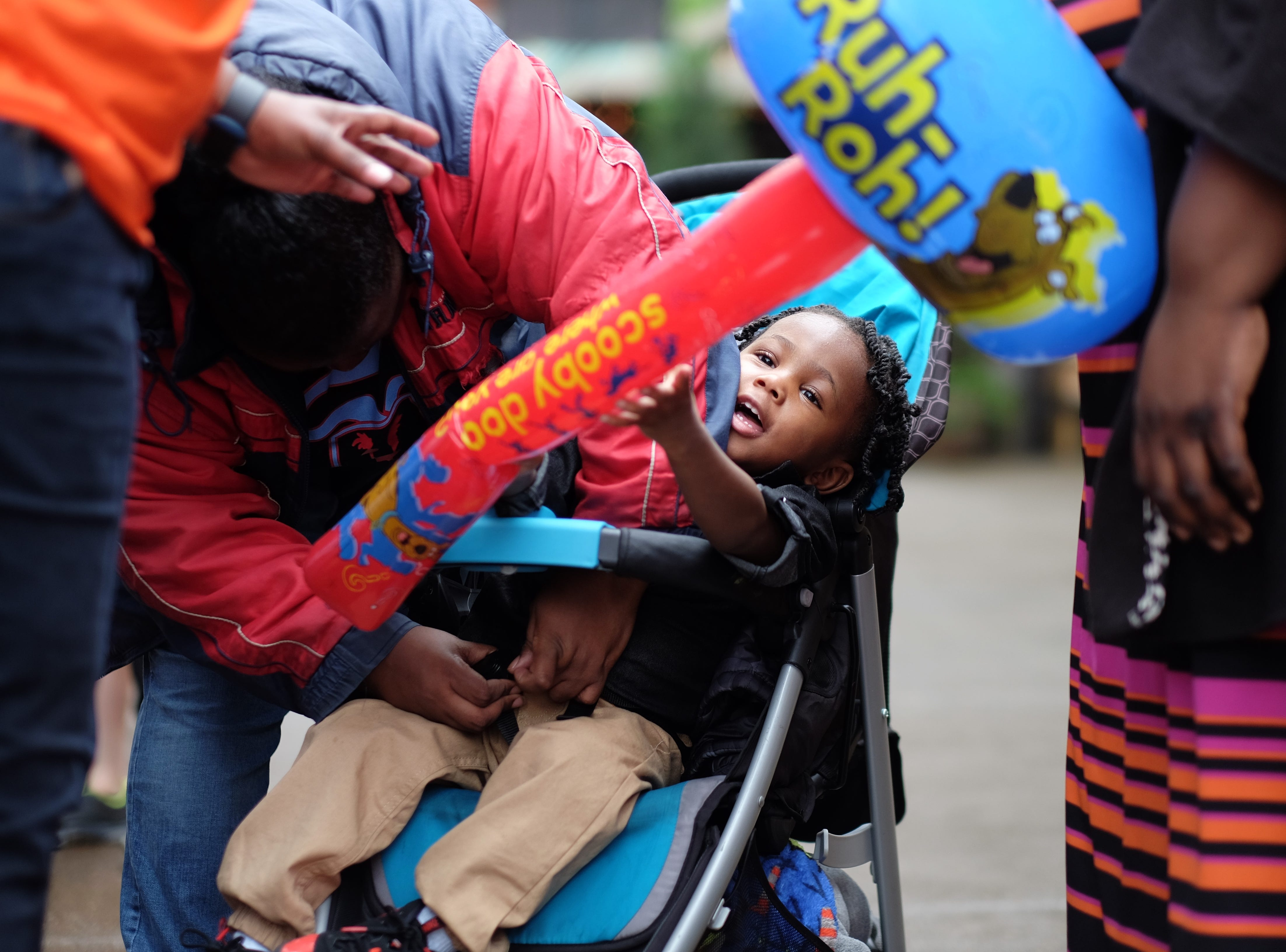 Jakevias Warren, 2, plays with his new inflatable toy during the Rossini Festival in Knoxville on Saturday, April 13, 2019. (Shawn Millsaps/Special to News Sentinel)