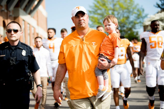 Tennessee Head Coach Jeremy Pruitt walks with his son Flynt during the Vol Walk at the Tennessee Spring Game at Neyland Stadium in Knoxville, Tennessee on Saturday, April 13, 2019.