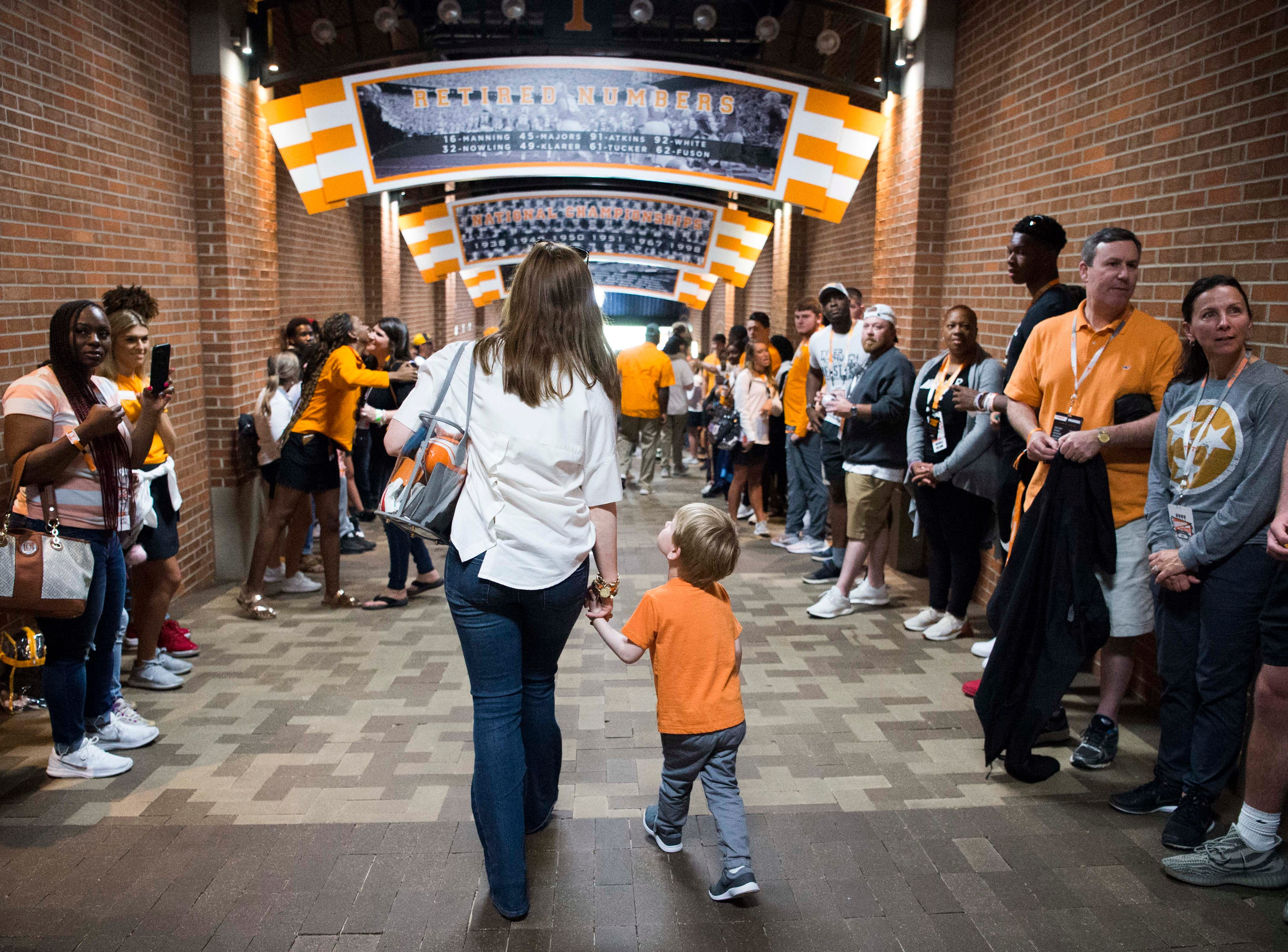 Casey Pruitt walks into Neyland with son Ridge before the Vols spring game in Knoxville Saturday, April 13, 2019.