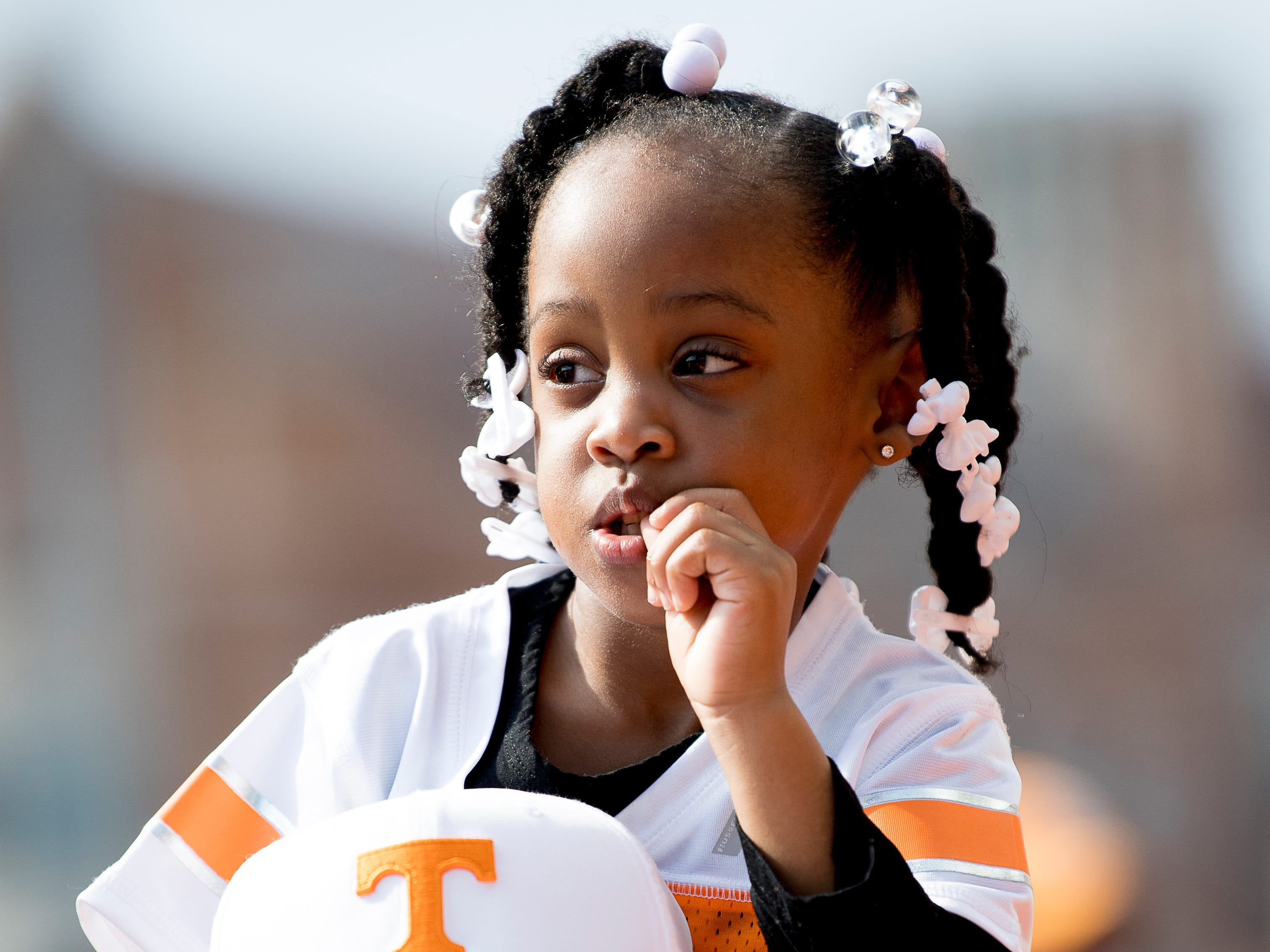 A young fan gets a better view during the Vol Walk at the Tennessee Spring Game at Neyland Stadium in Knoxville, Tennessee on Saturday, April 13, 2019.