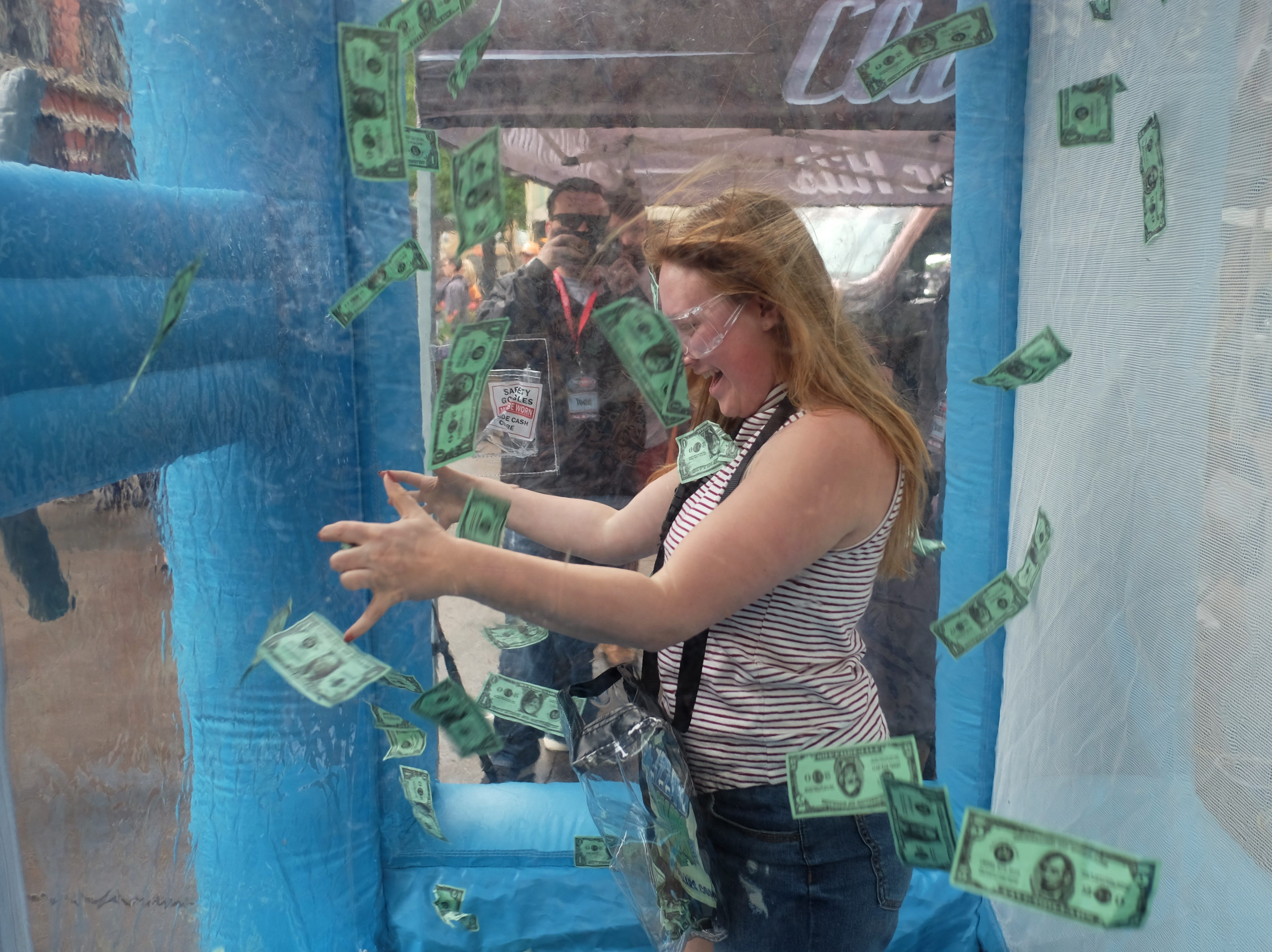 Seirra Trott tries to capture money during the Rossini Festival in Knoxville on Saturday, April 13, 2019. (Shawn Millsaps/Special to News Sentinel)