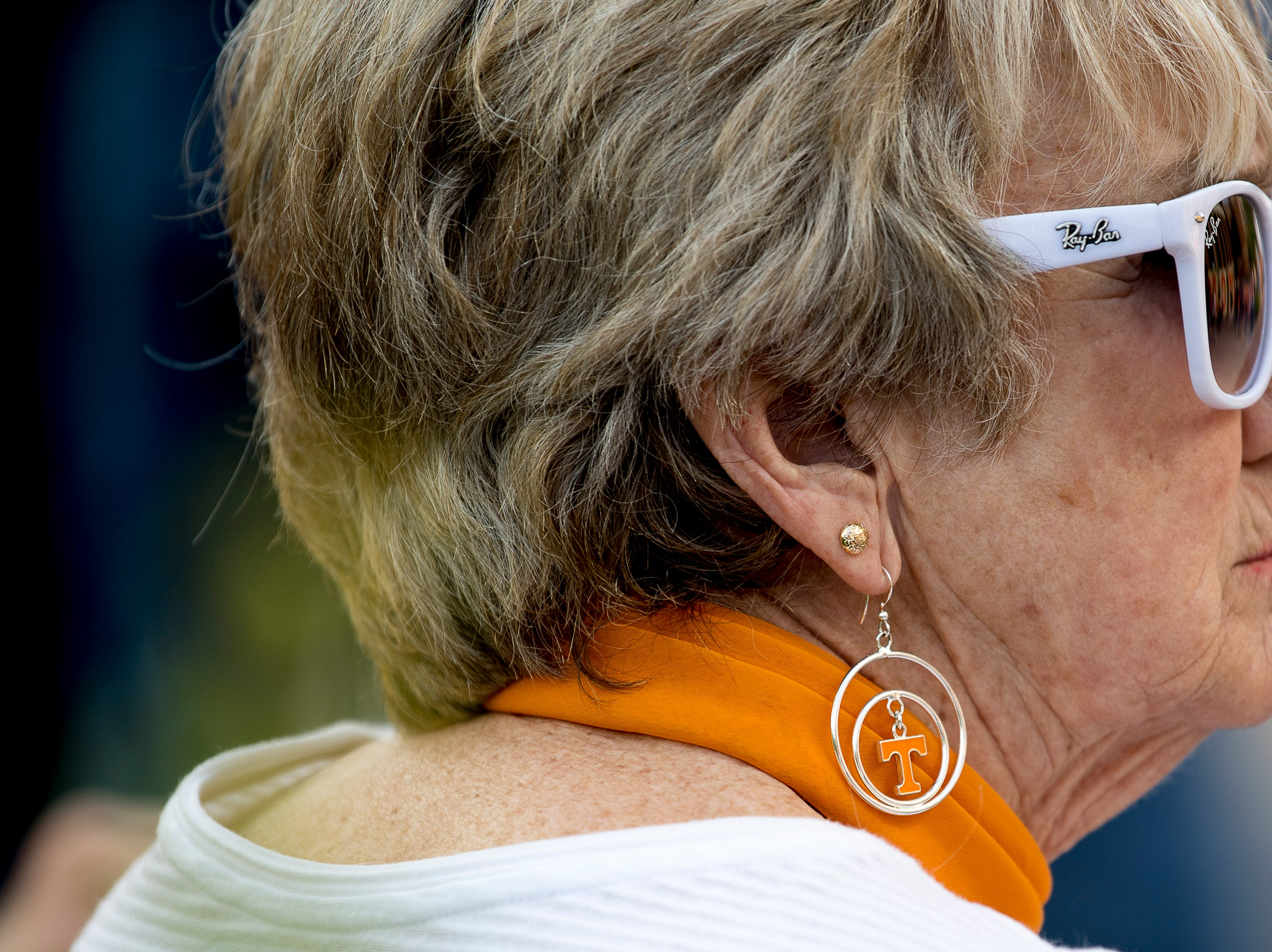 Jo Adams, of Dayton, sports stylish Tennessee earrings at the Tennessee Spring Game at Neyland Stadium in Knoxville, Tennessee on Saturday, April 13, 2019.