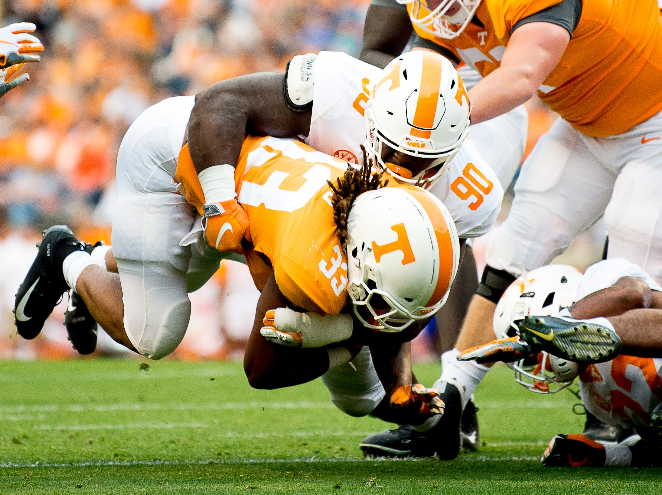Tennessee running back Ramsey Hailey (35) is taken down by Tennessee defensive lineman Greg Emerson (90) during the Tennessee Spring Game at Neyland Stadium in Knoxville, Tennessee on Saturday, April 13, 2019.