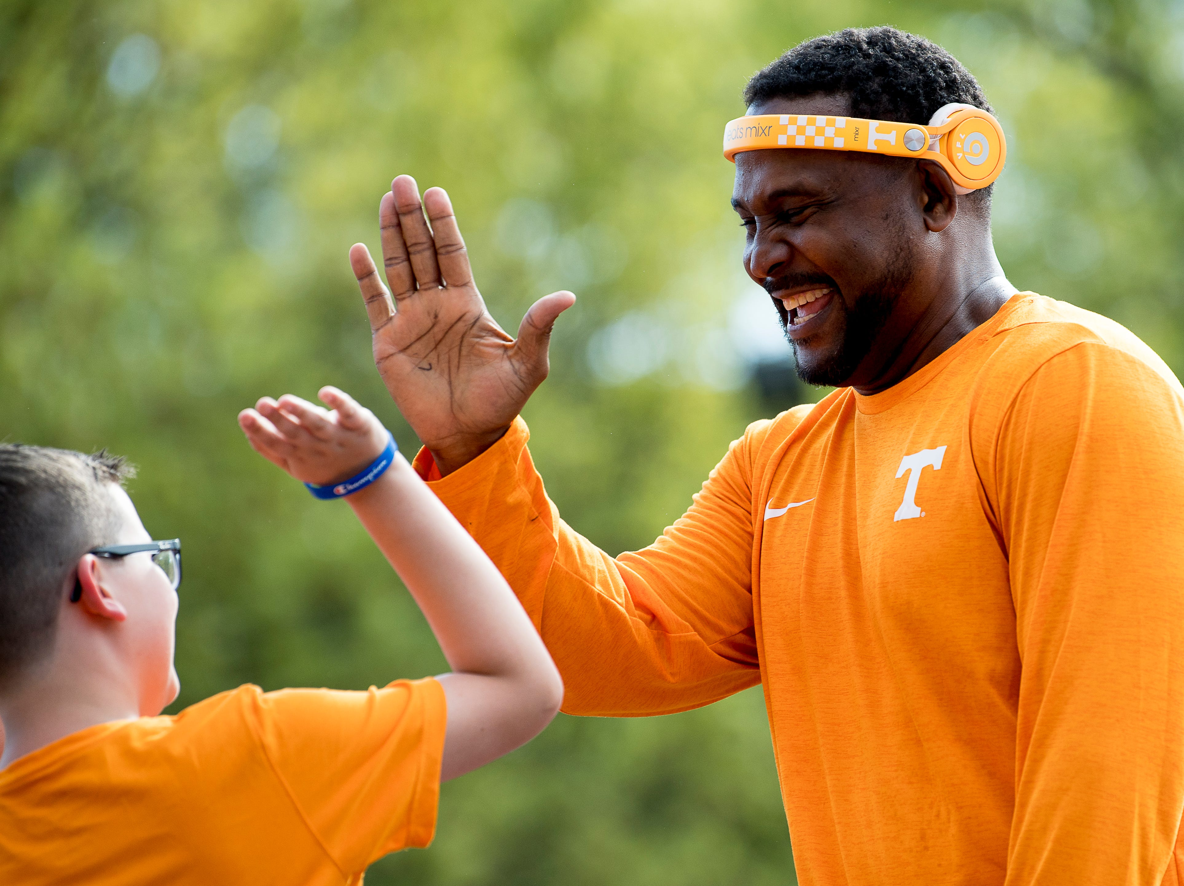 Former Tennessee quarterback DJ Sterl the Pearl high fives a young fan at the Tennessee Spring Game at Neyland Stadium in Knoxville, Tennessee on Saturday, April 13, 2019.