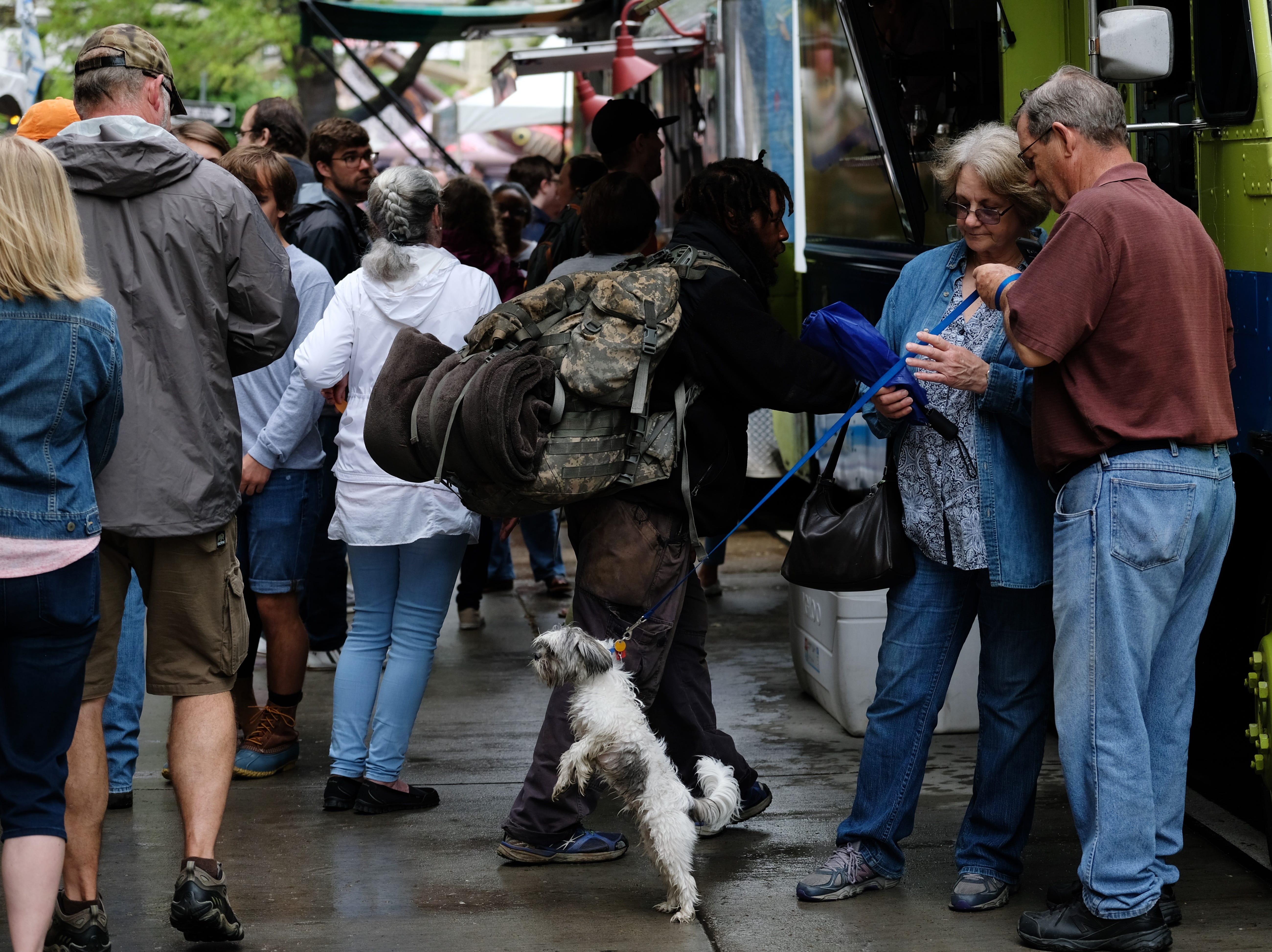 Festival goers Carol and Rich Tegethoff along with their dog Bentley take a break during the Rossini Festival in Knoxville on Saturday, April 13, 2019. (Shawn Millsaps/Special to News Sentinel)